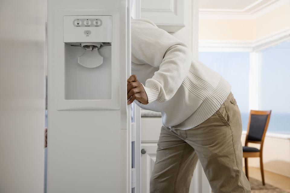person using freezer