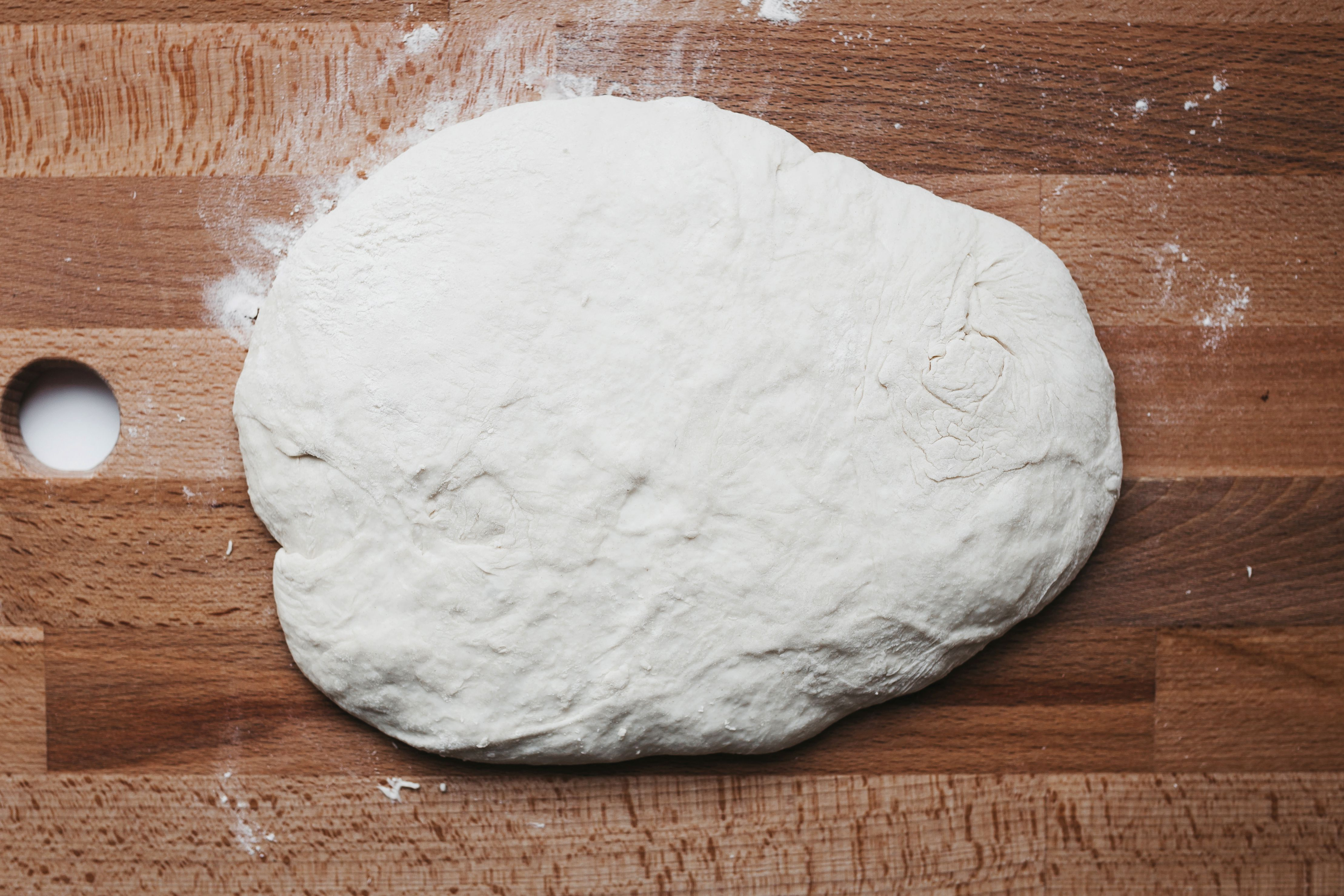 After the dough has risen, turn it out onto a floured work surface