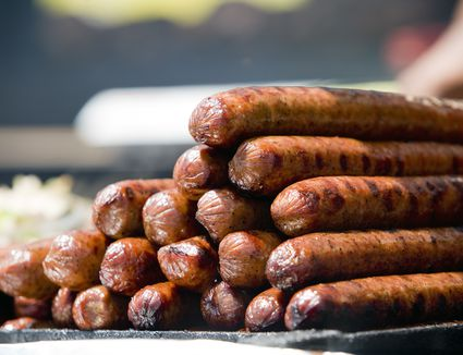 A lot of grilled sausages ready to eat