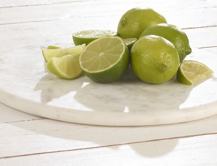 Whole and sliced limes