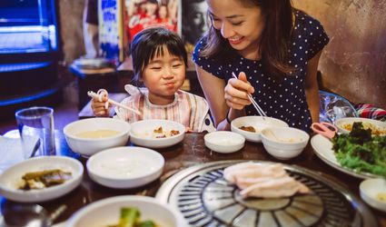 A mother and child having a meal in Korean restaurant