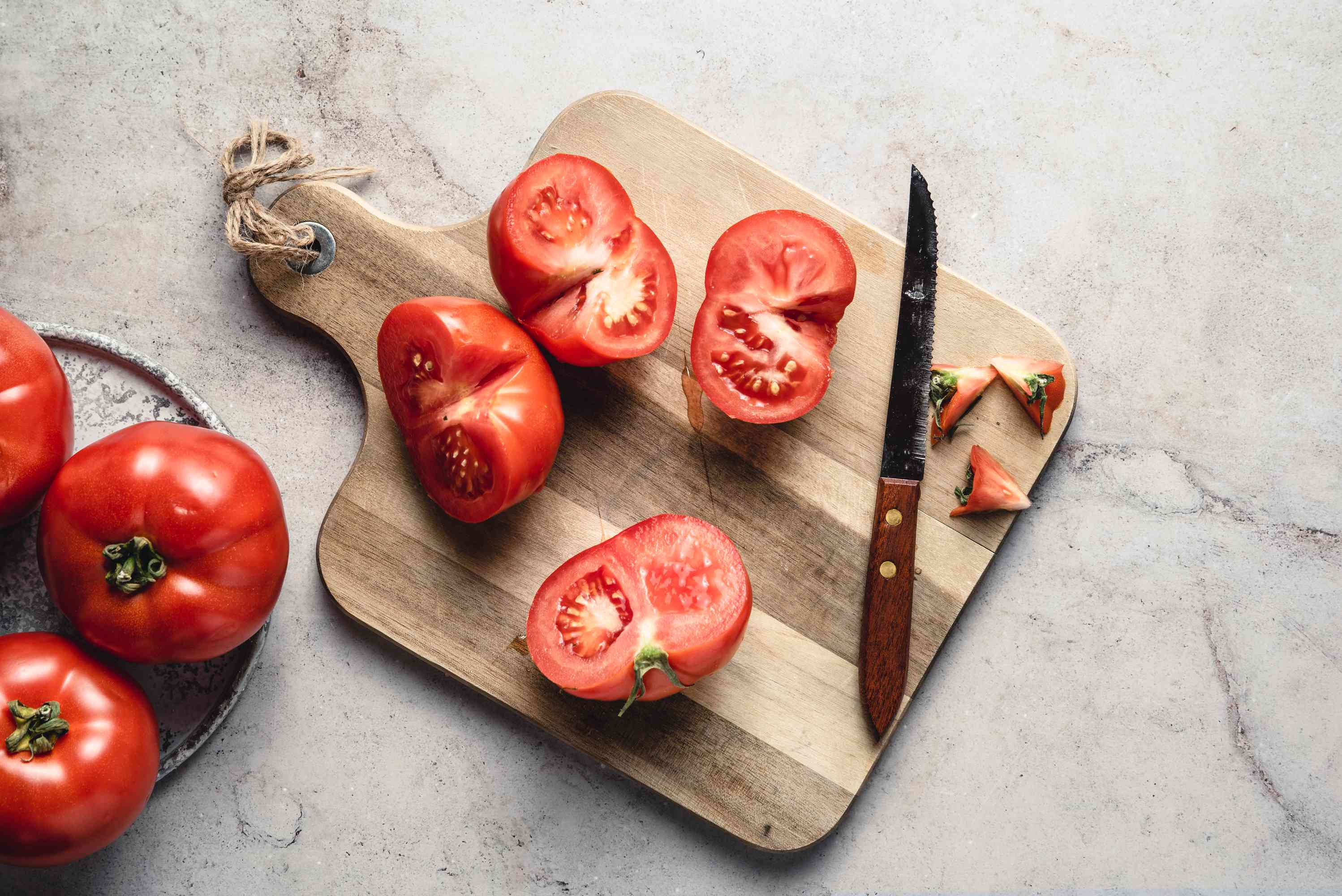Remove the stems of the tomatoes and cut the tomatoes in half