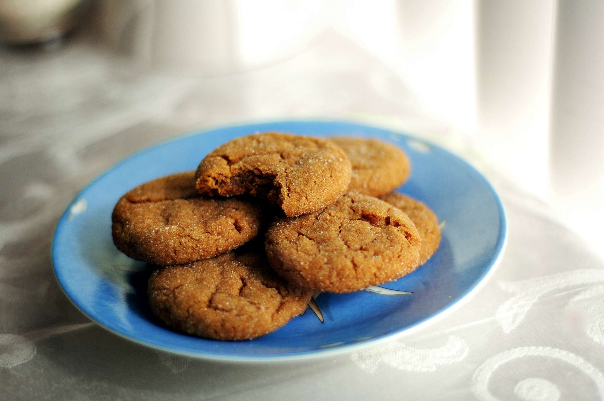 Gluten-free molasses and ginger cookies on a serving plate