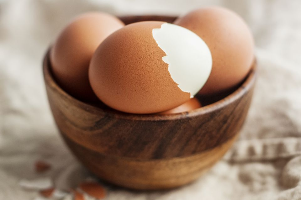 Hard-boiled eggs in a wooden bowl