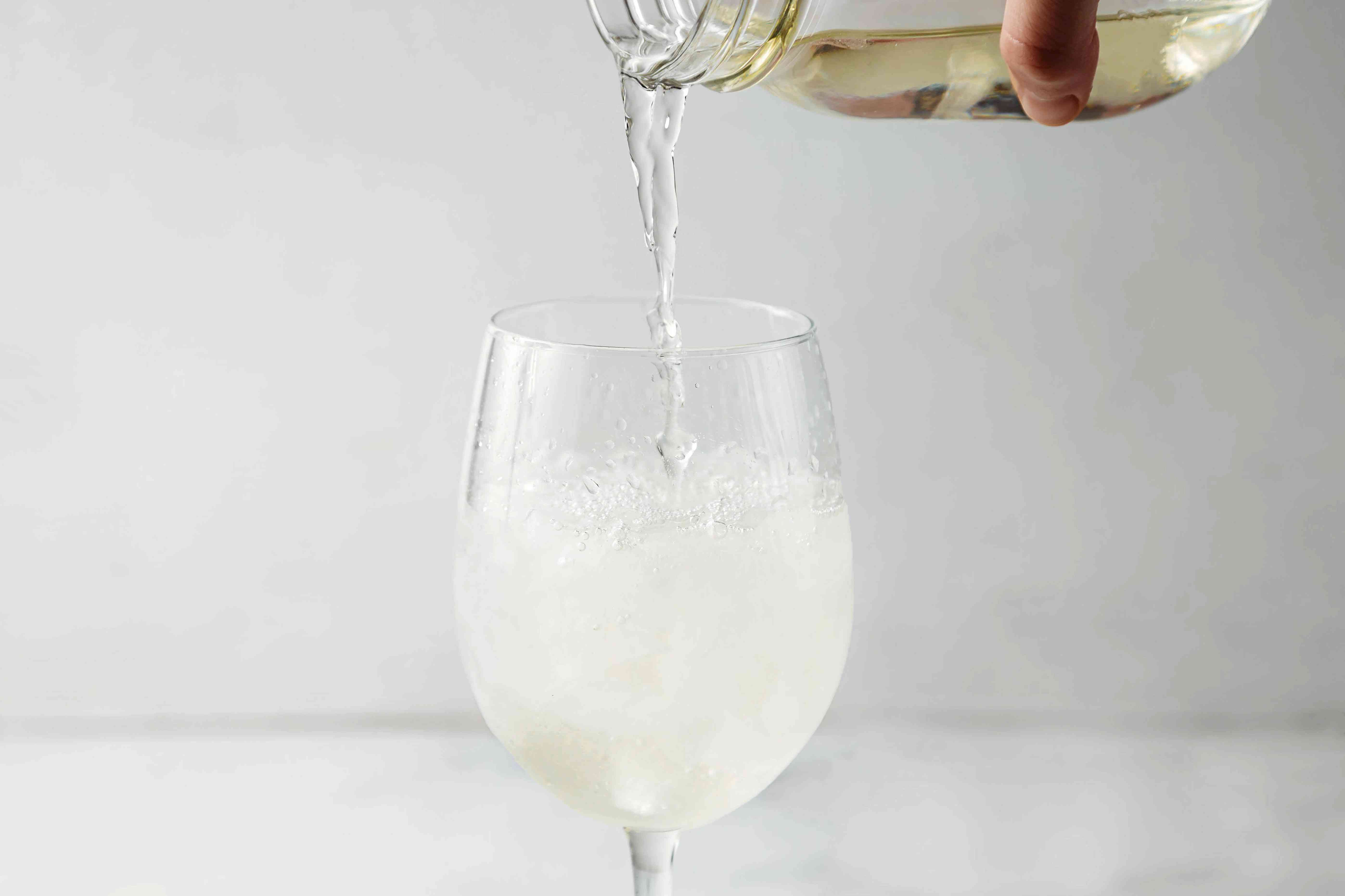 Wine poured into a glass with ice