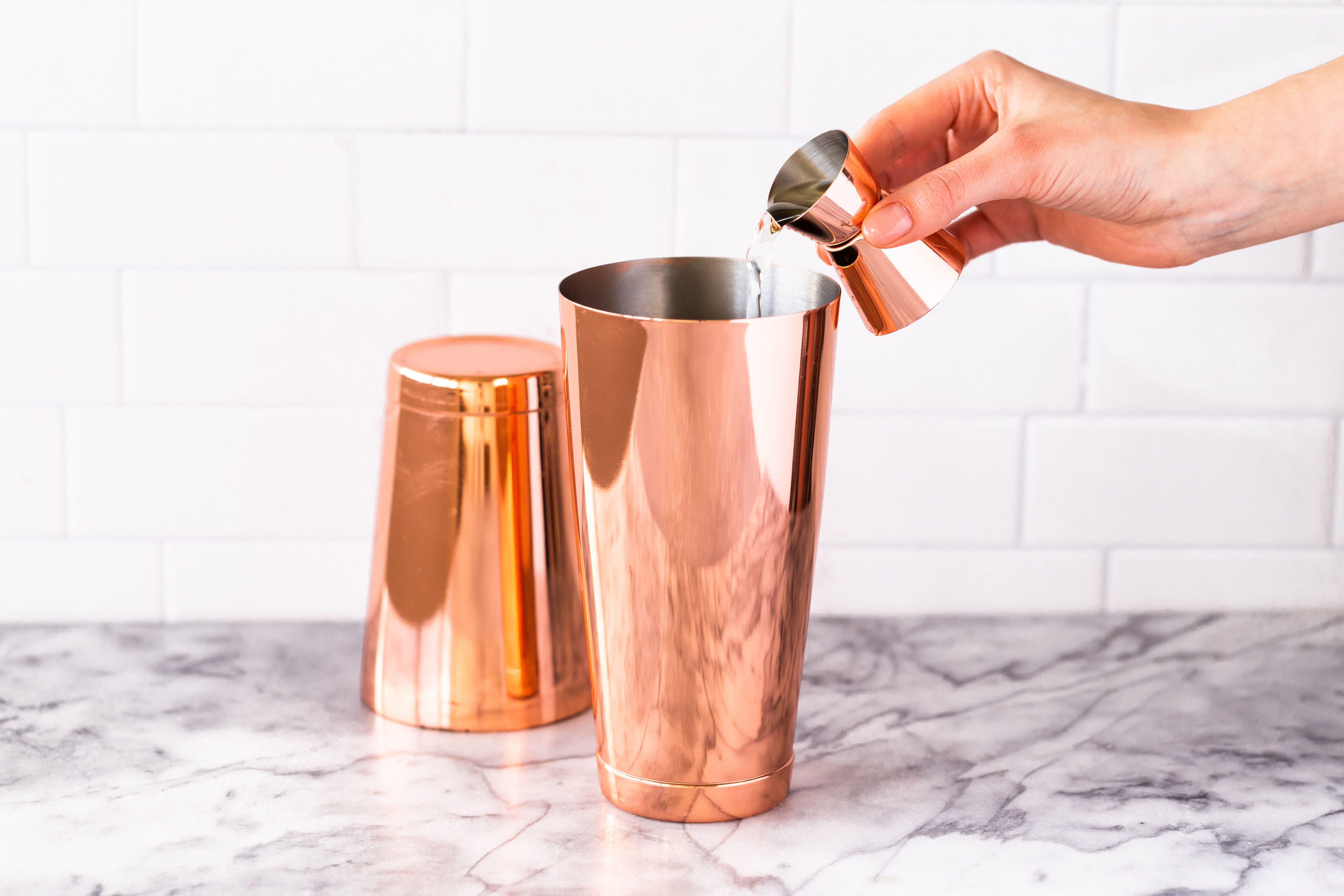 Pour vodka in shaker
