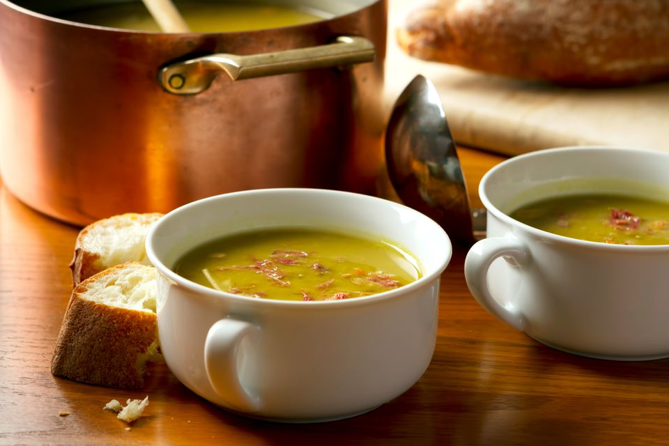Homemade split pea soup made with smoked bacon and served with crusty french bread