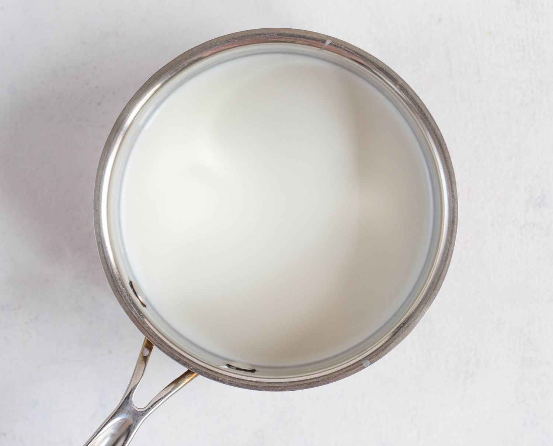Heating milk and cream in a saucepan