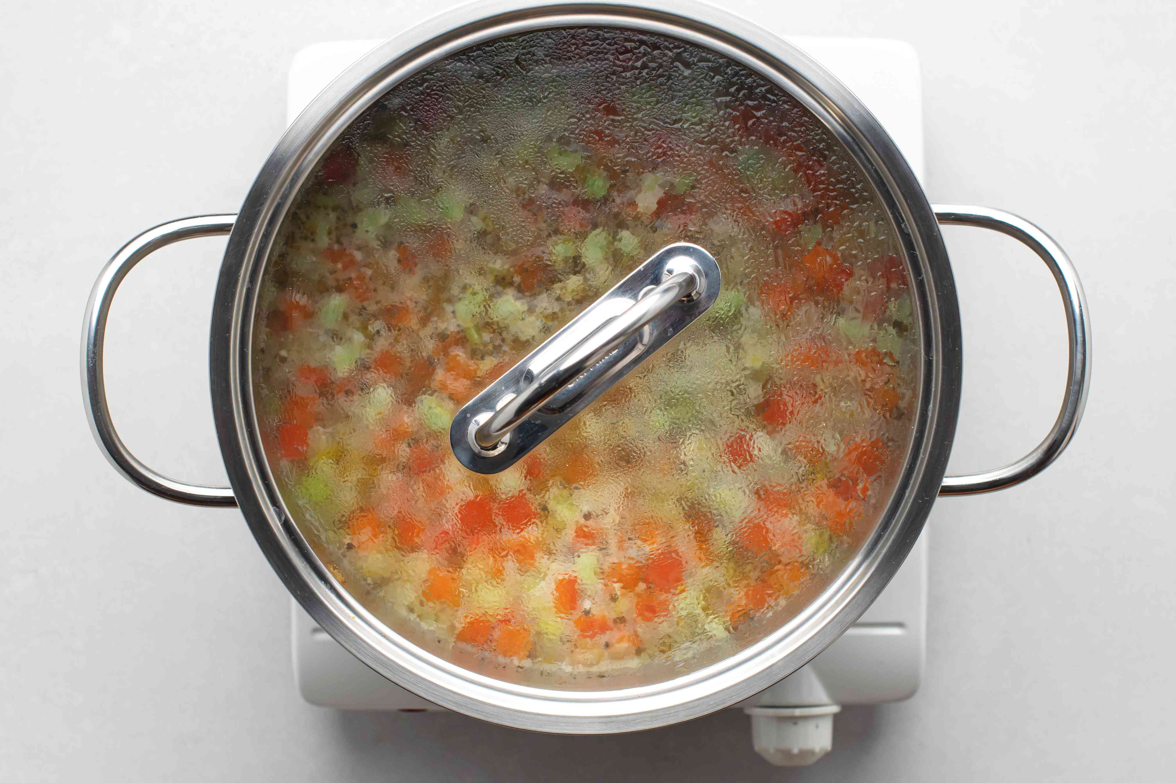 bean soup cooking in a pot