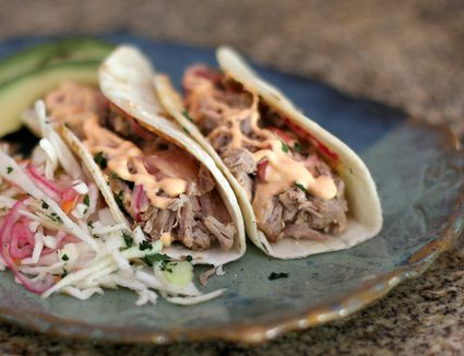 Pulled Pork Tortillas with avocado on a blue plate