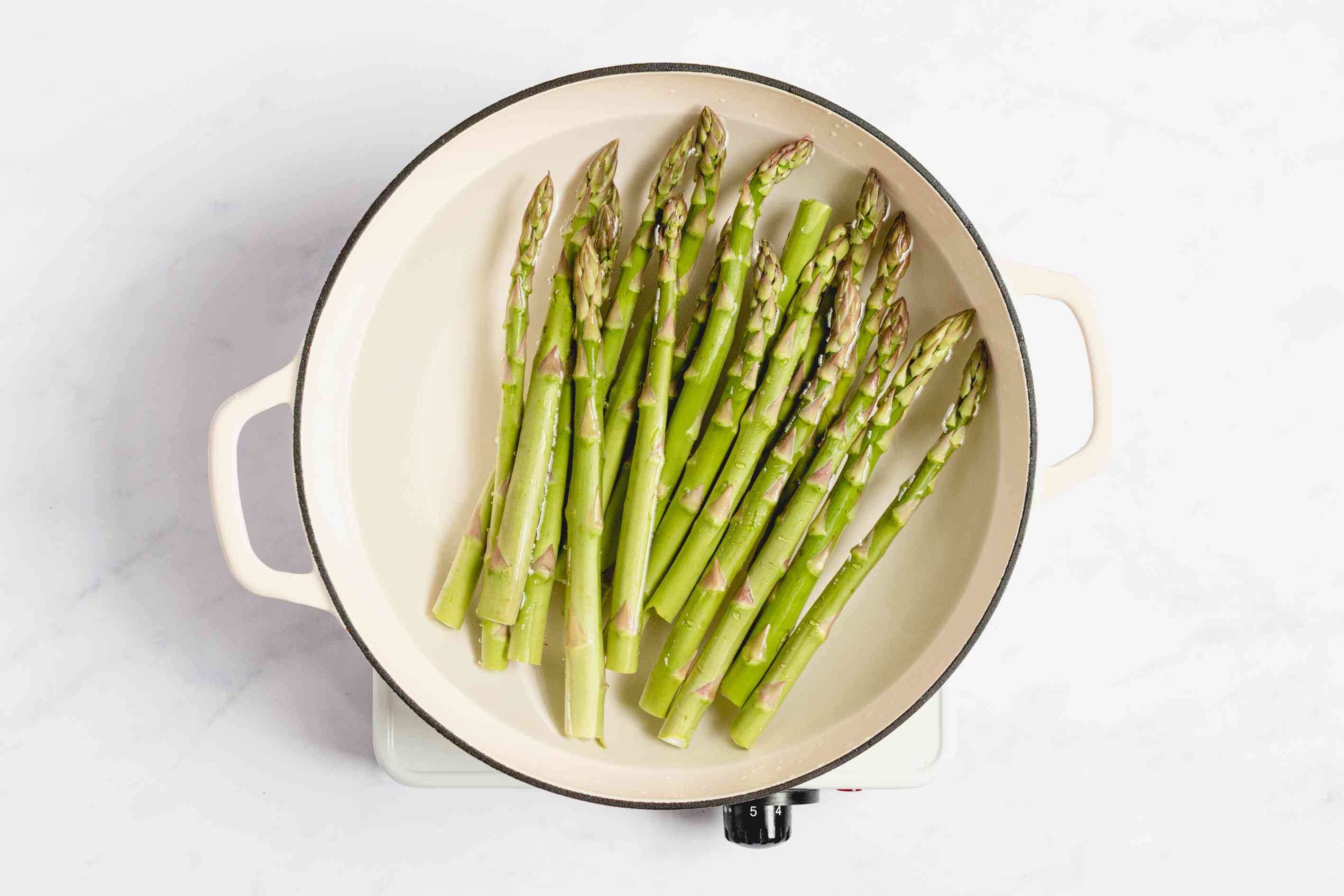 Place the asparagus in a wide shallow saucepan