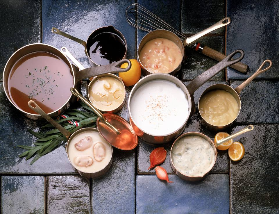 Assortment of sauce in copper pots