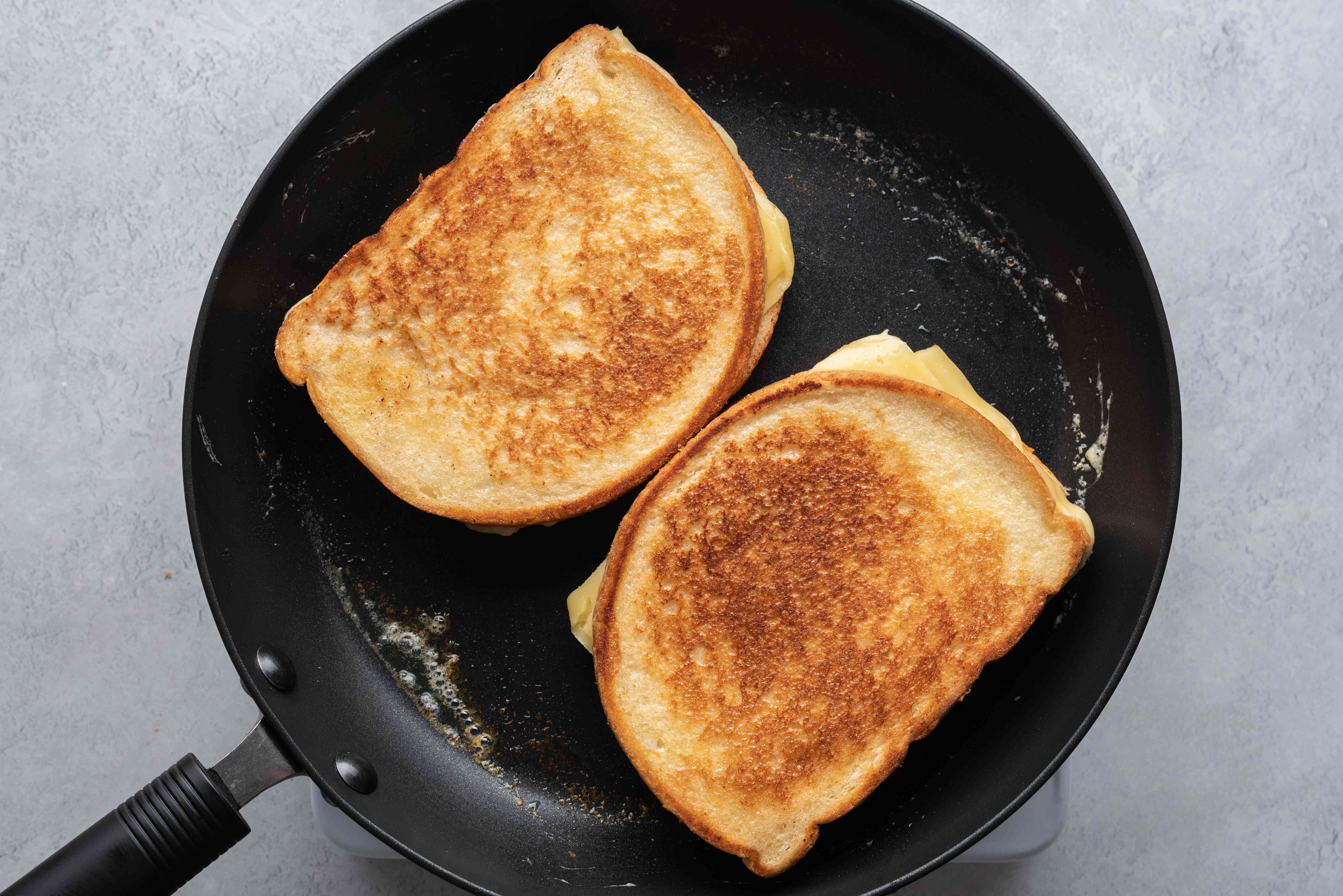 sandwiches being grilled in a pan until golden brown
