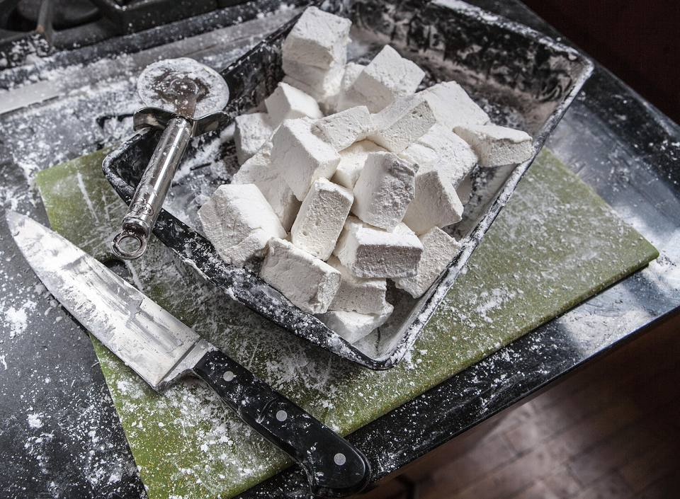 Marshmallow Squares in Pan on Messy Counter