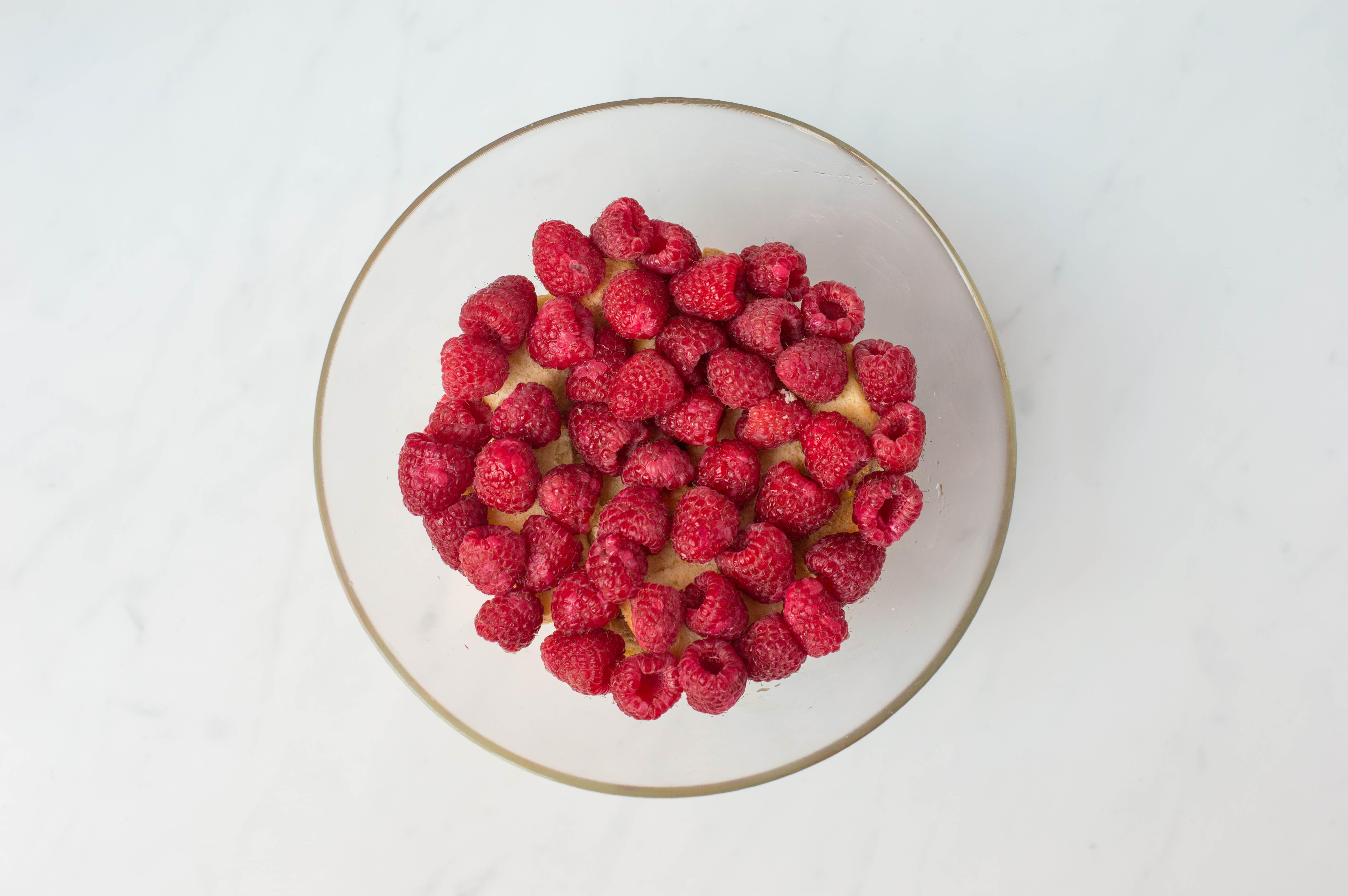 layer raspberries on top of cake