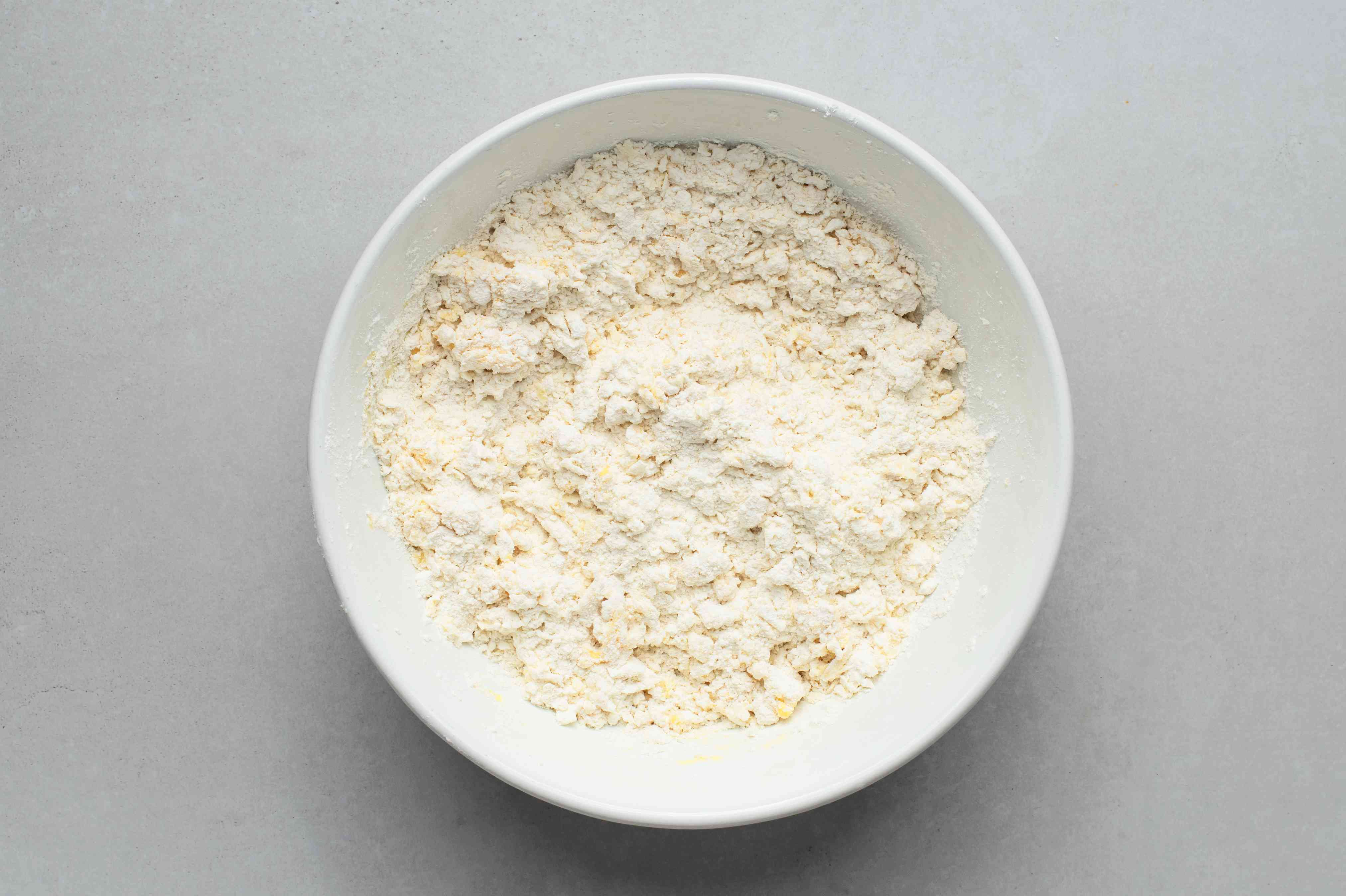 Flour, vegetable shortening, salt, baking powder, vinegar, egg, and vodka in a bowl