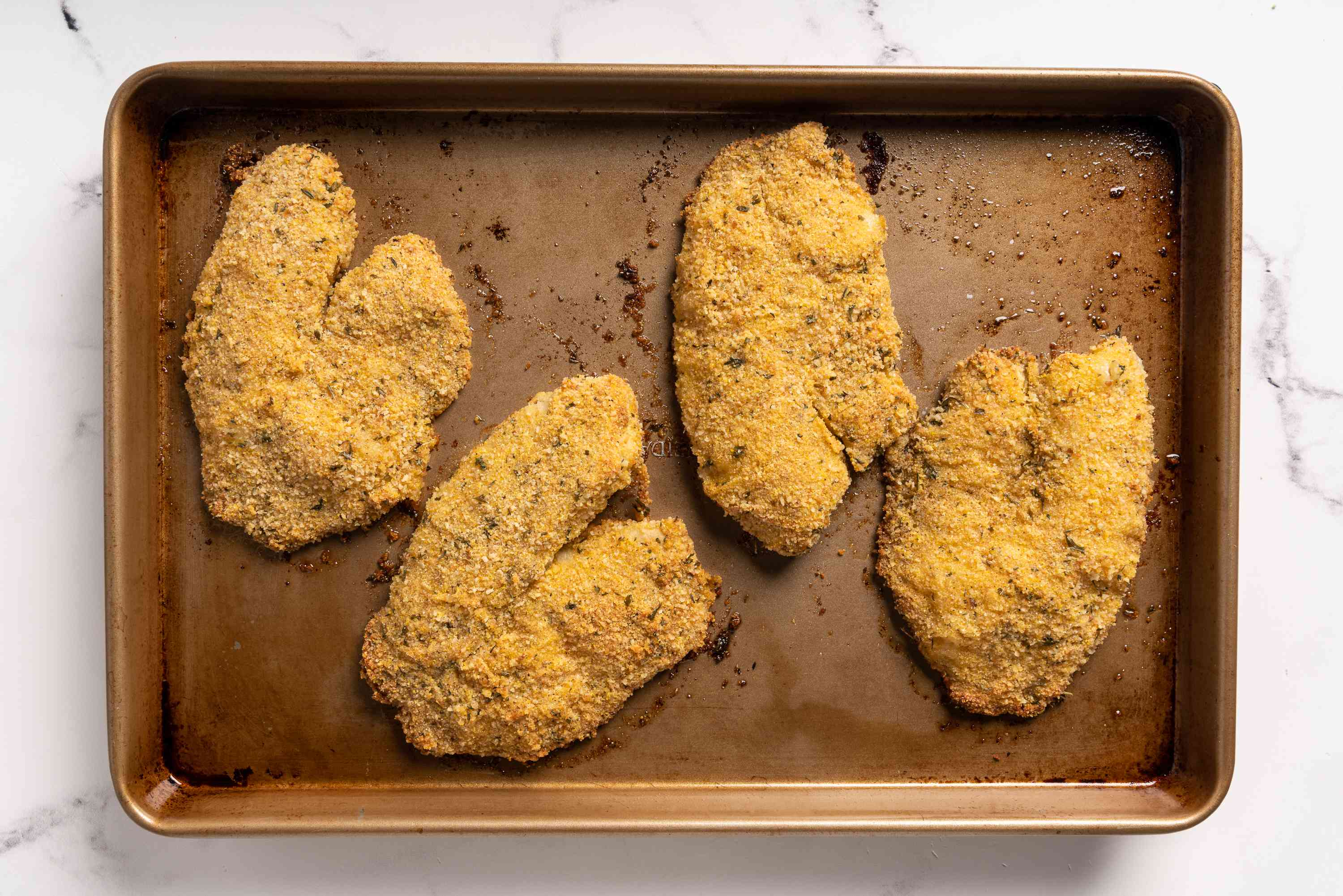 Simple Oven-Fried Tilapia on a baking sheet