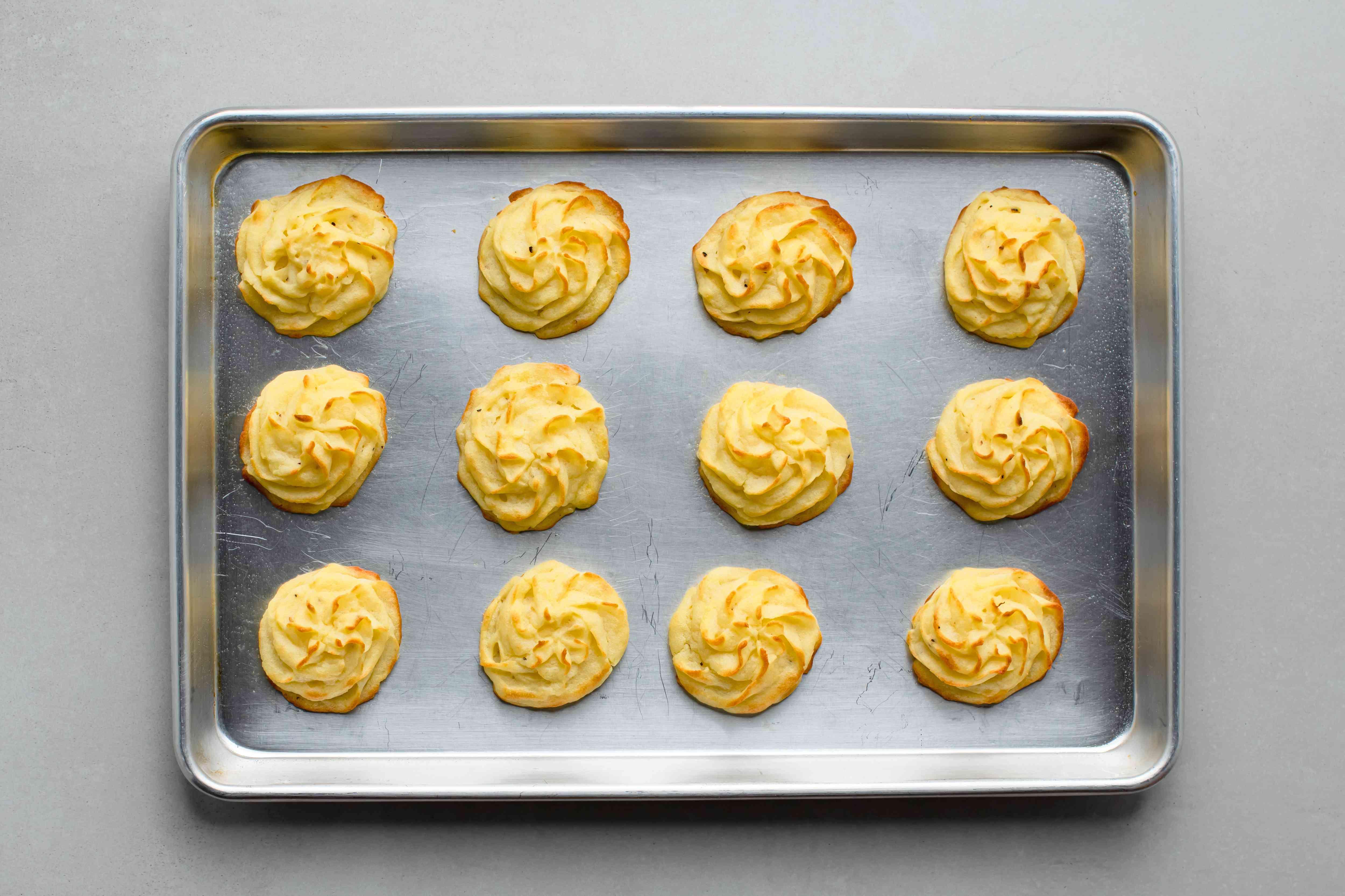 Make-Ahead Duchess Mashed Potatoes on a baking sheet
