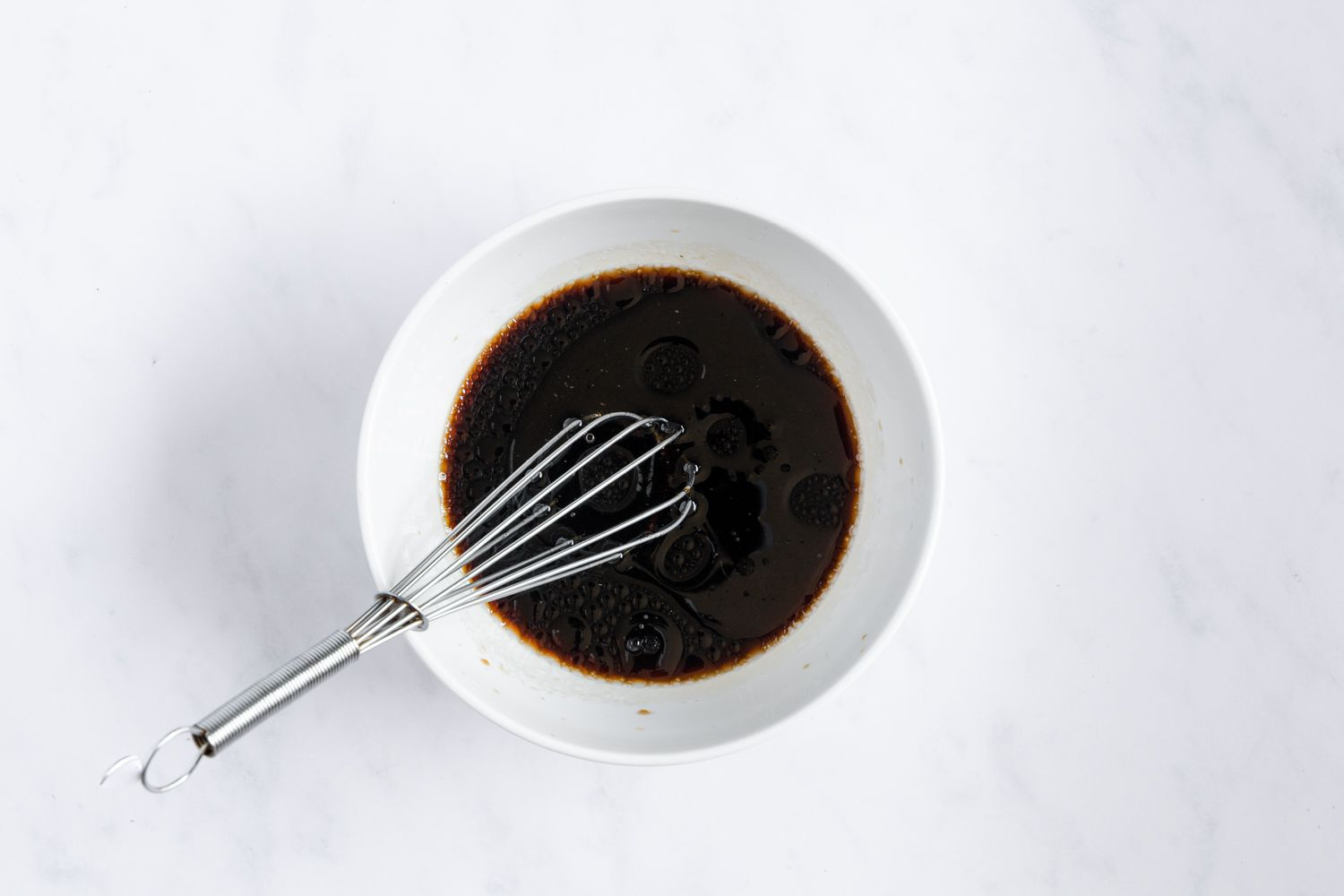 whisk together the red wine vinegar, soy sauces, and Asian sesame oil in a bowl