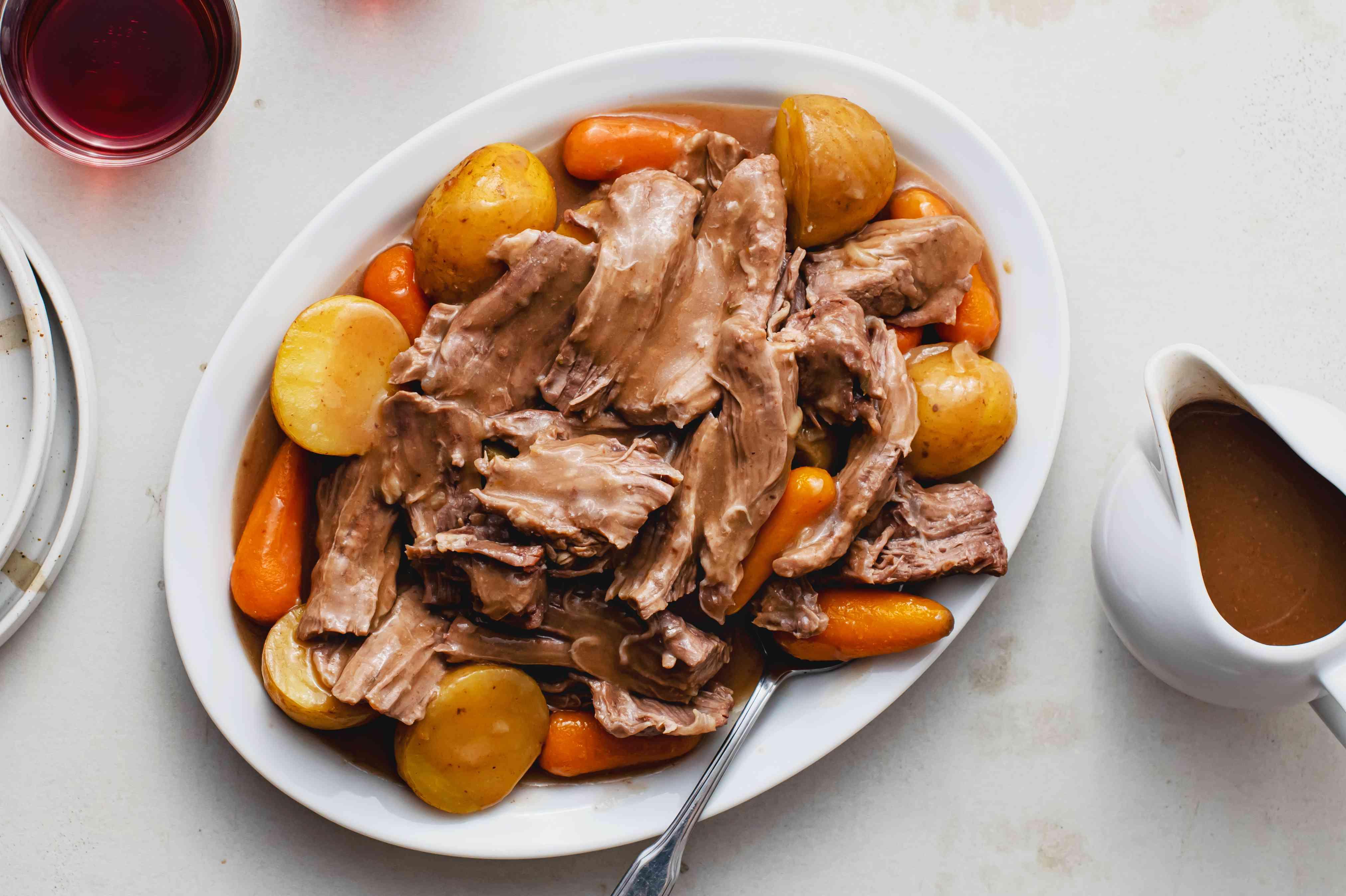 Crock Pot Onion Soup Beef Pot Roast recipe, on a white plate