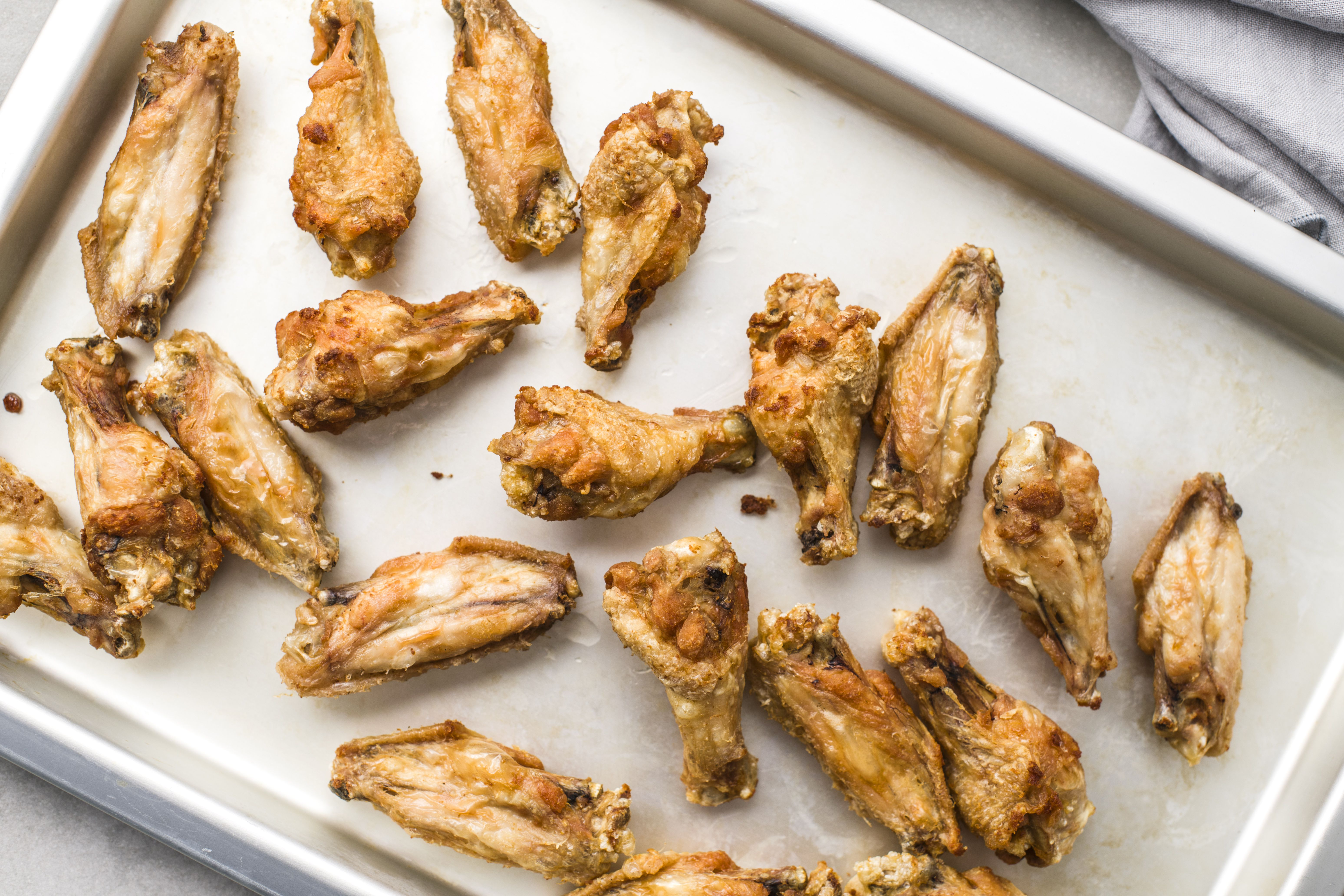 Remove wings with a slotted spoon to a baking sheet
