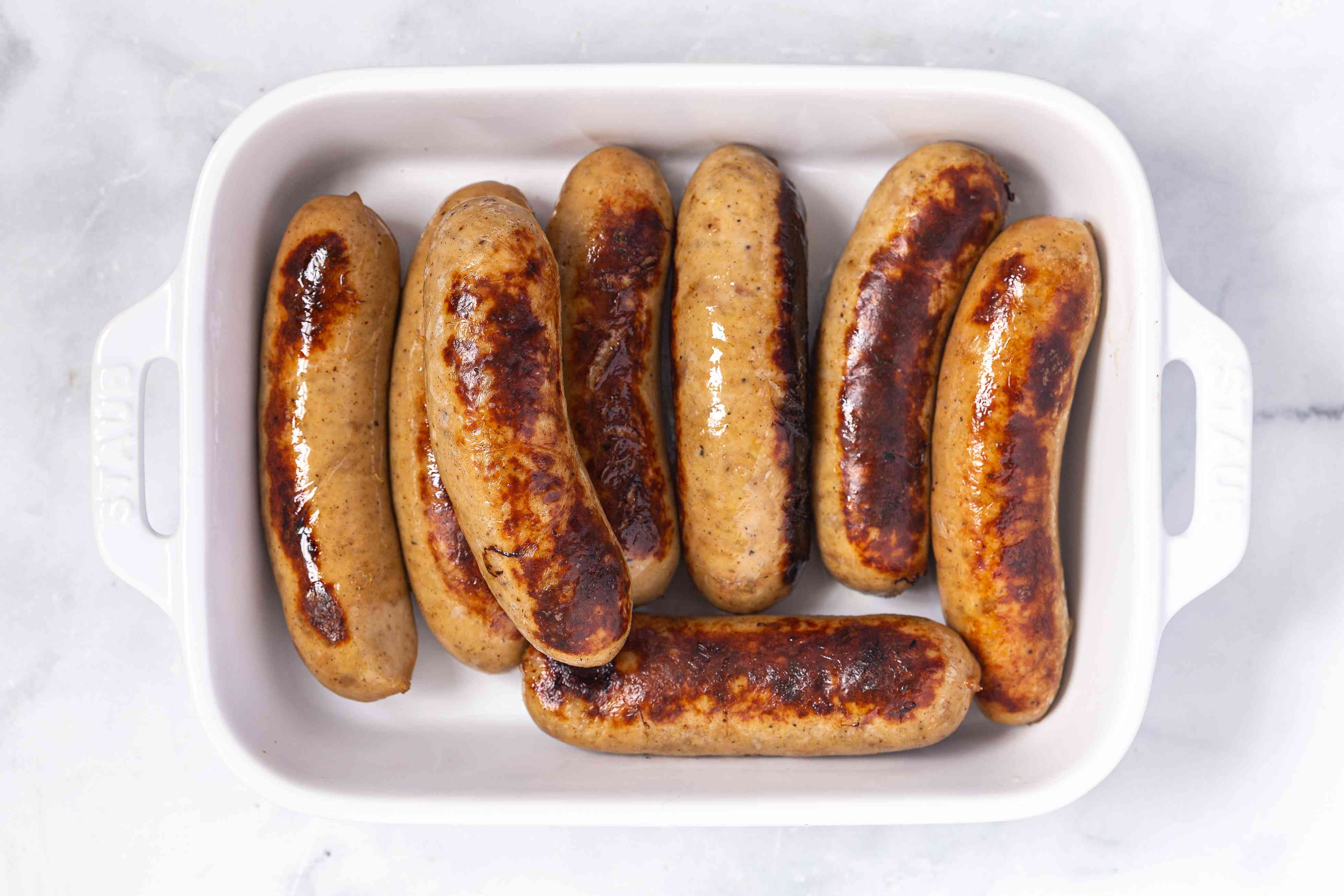 Cooked sausages in a casserole dish