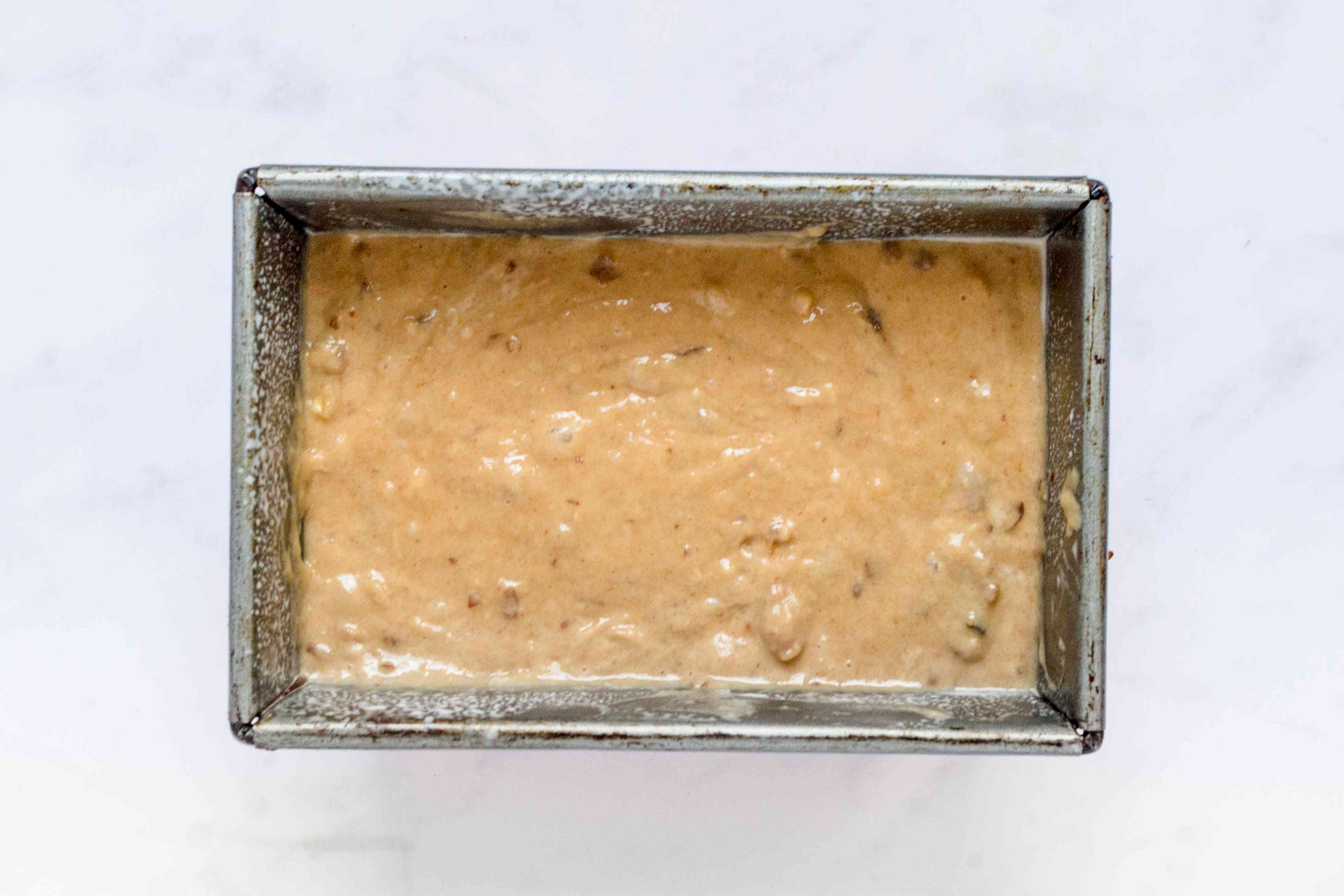 Date nut bread batter in a loaf pan