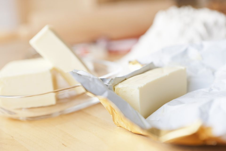 Close up of unwrapped stick of butter