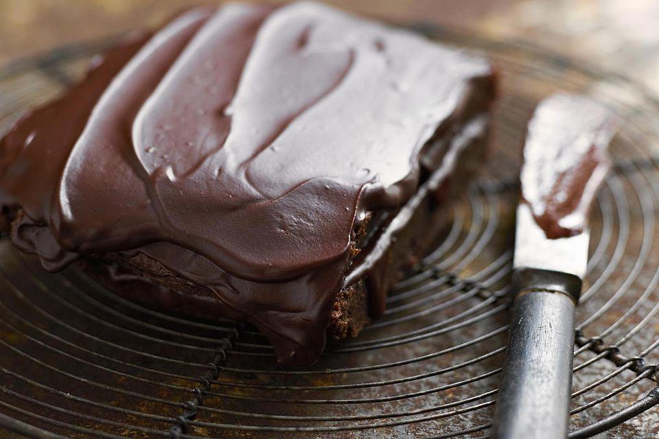 Silky chocolate icing on a brownie