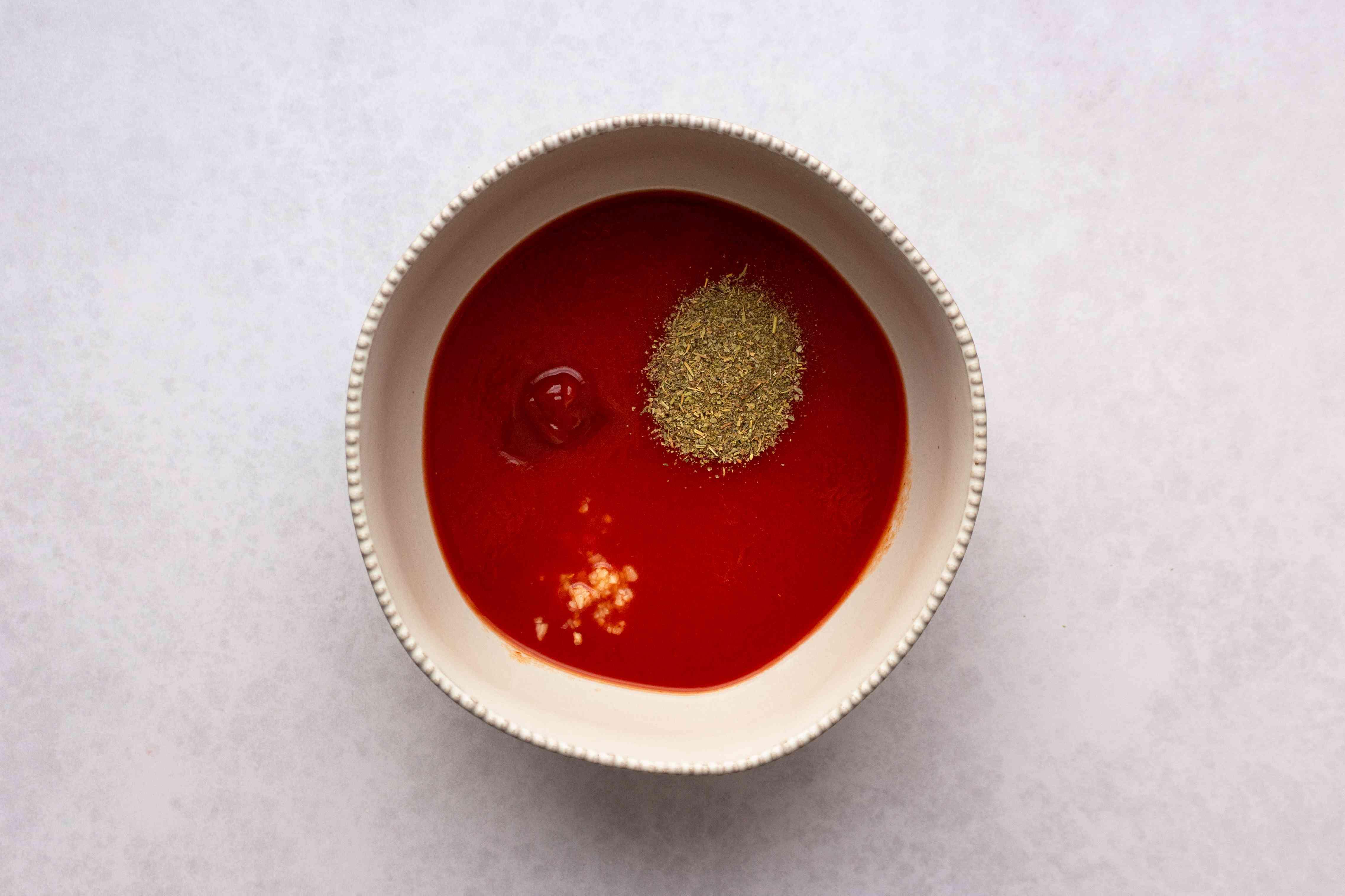 tomato juice, ketchup, minced garlic, Italian seasoning and salt in a bowl