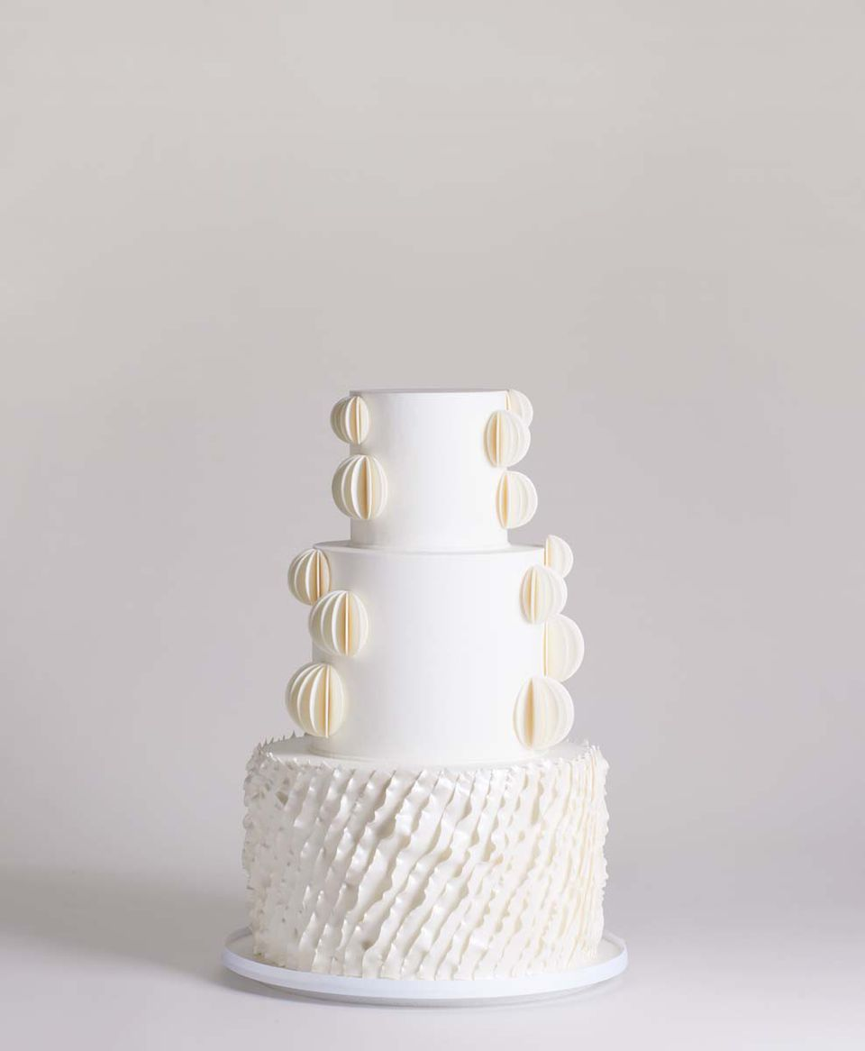 <p>White Wedding Cake with Fondant Pleats and Ruffles</p>
