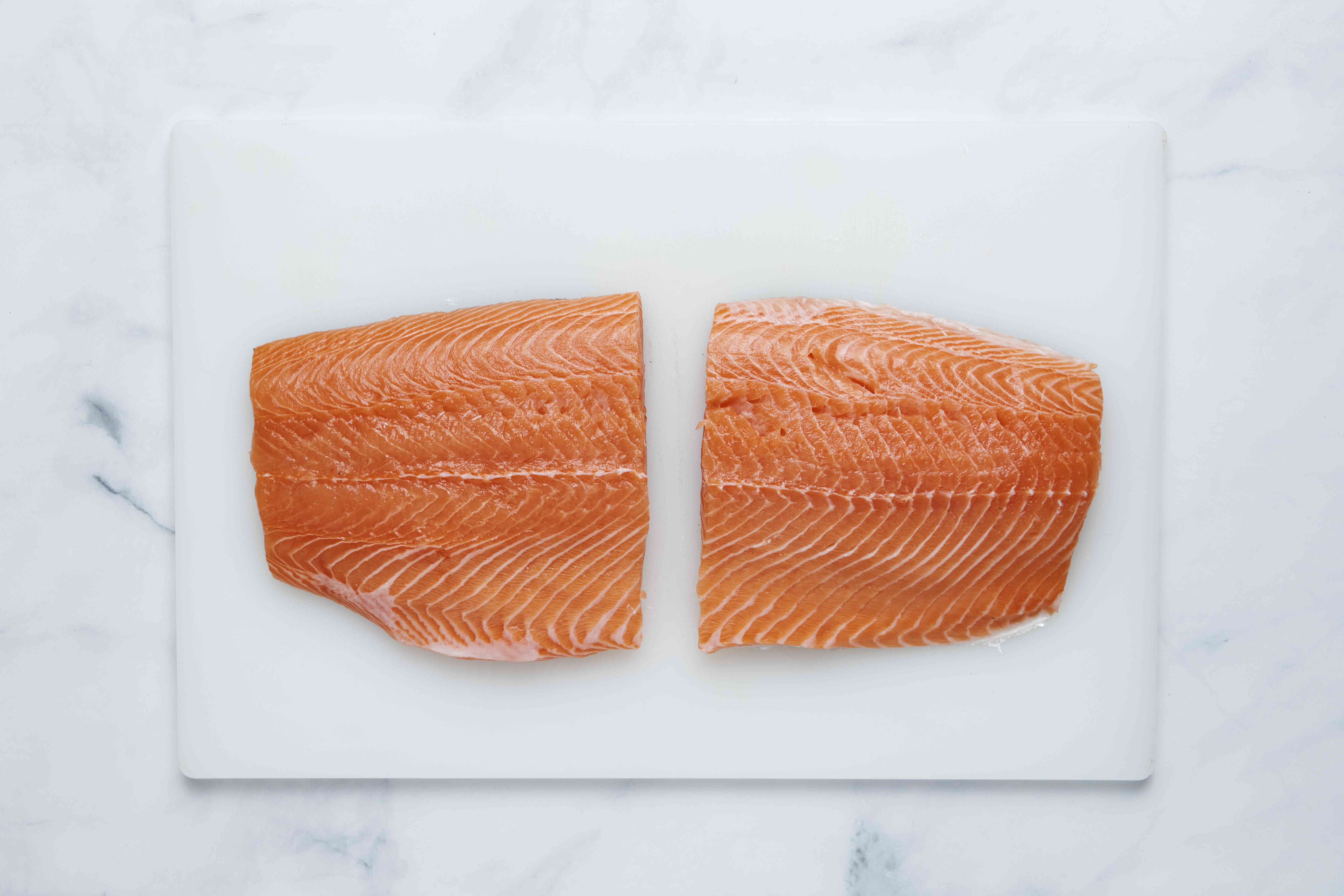 Cut the salmon in half across the fillet into two halves