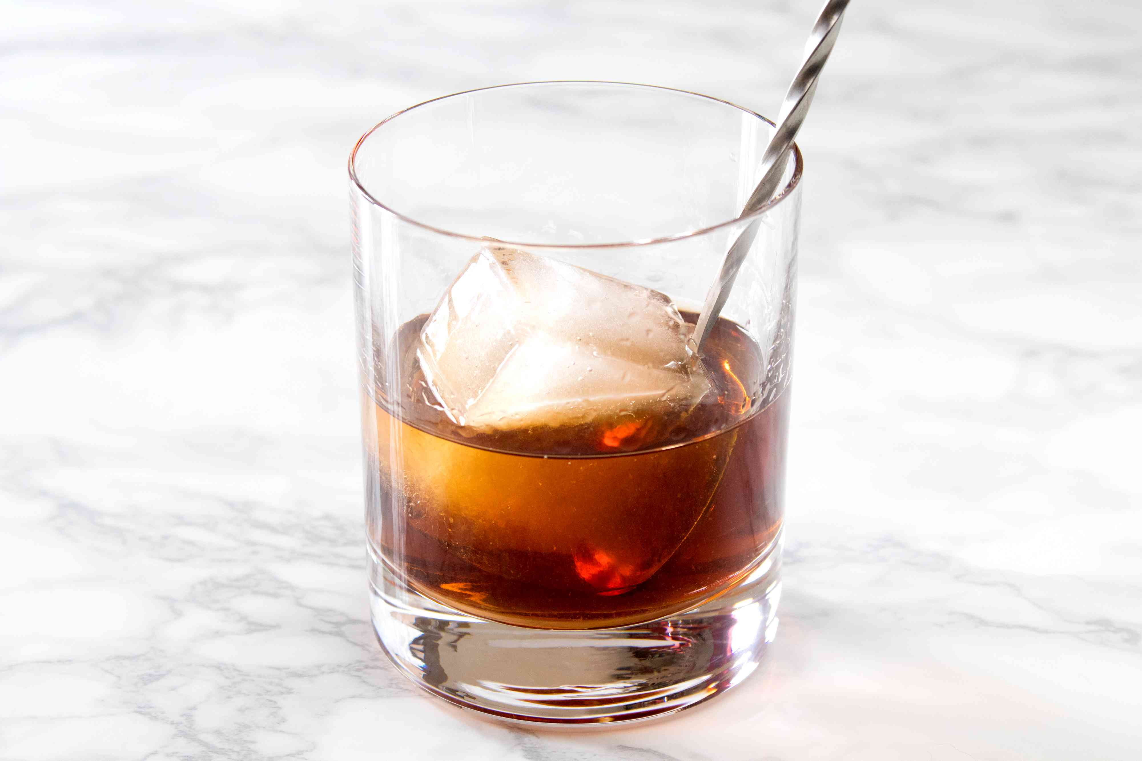 Mixing a Separator Cocktail With Brandy and Coffee Liqueur