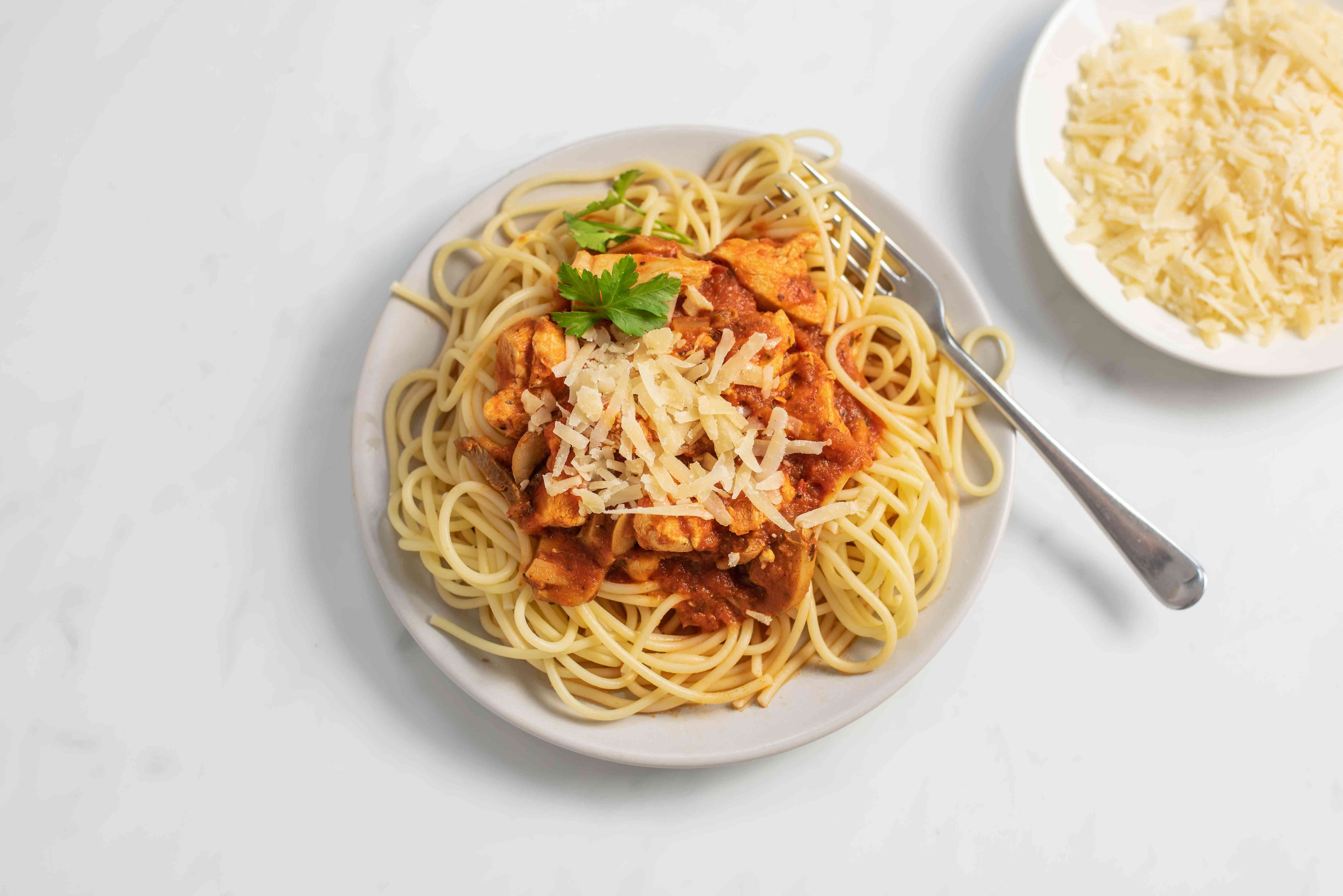 Plated chicken spaghetti with parmesan