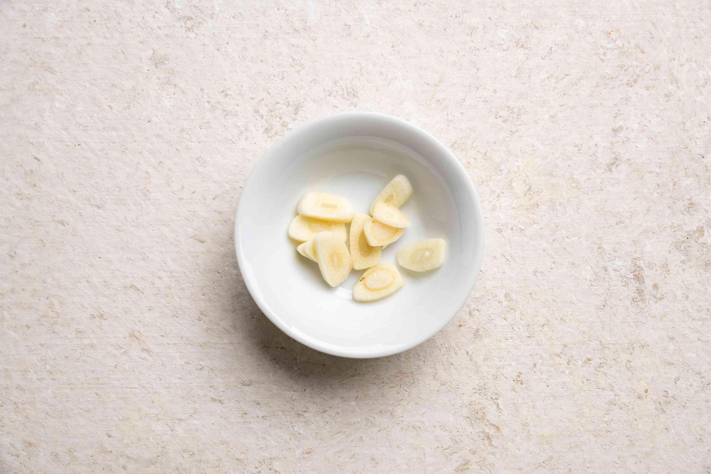 thin garlic slices in a bowl