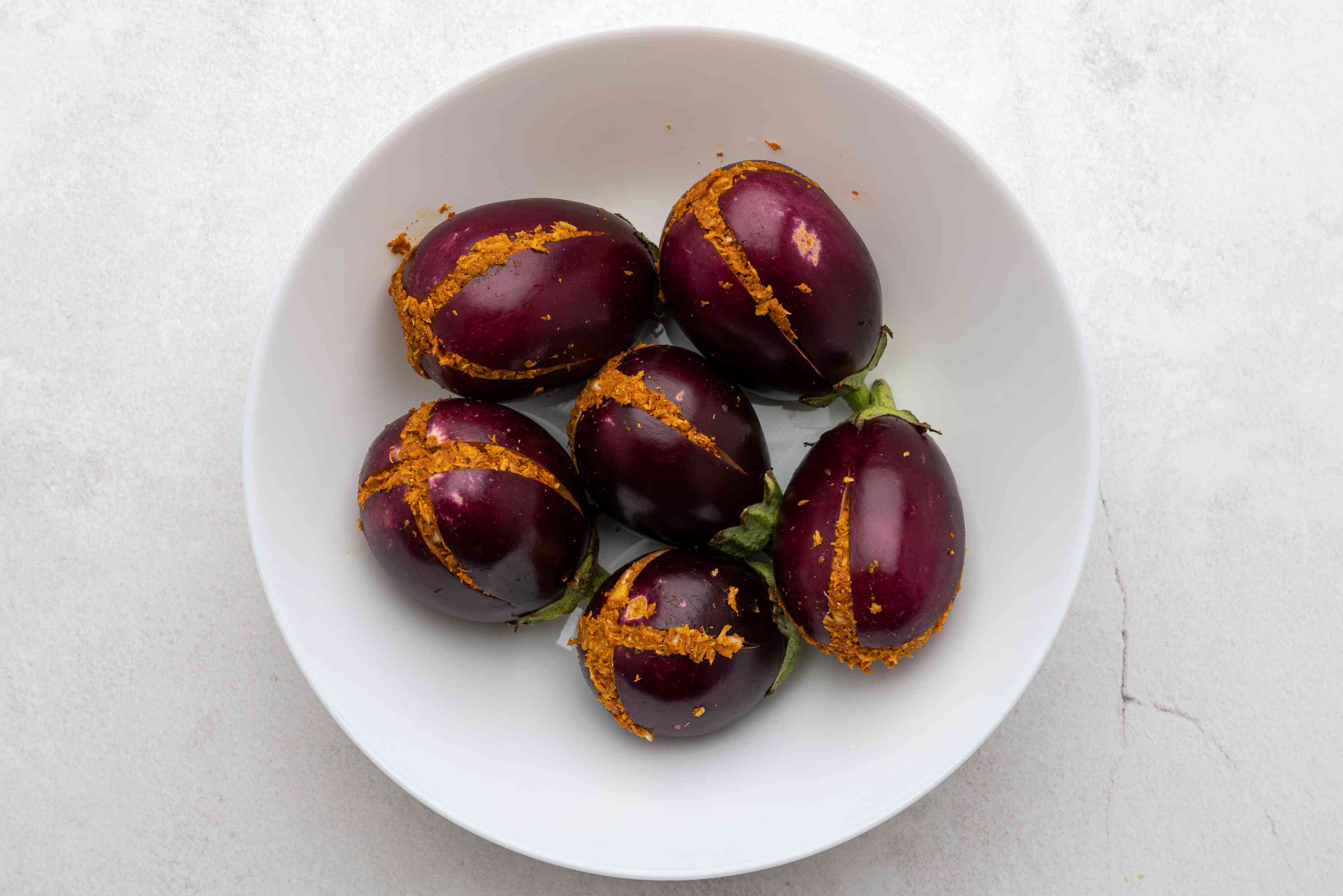 Fill the slits in the eggplants with this spice paste