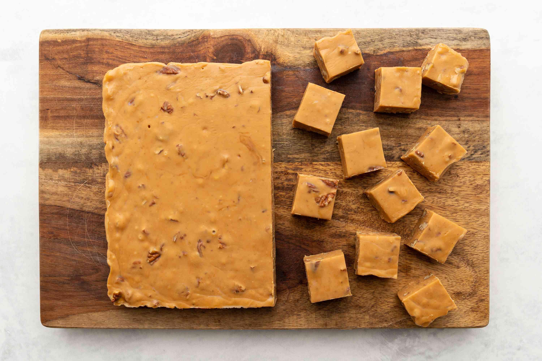 Dulce de Leche Fudge cut into pieces on a cutting board
