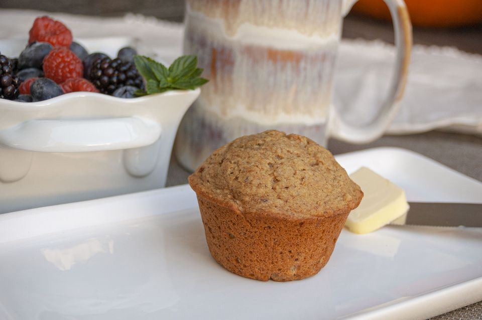 basic vegan muffin with coffee and fresh berries on the side