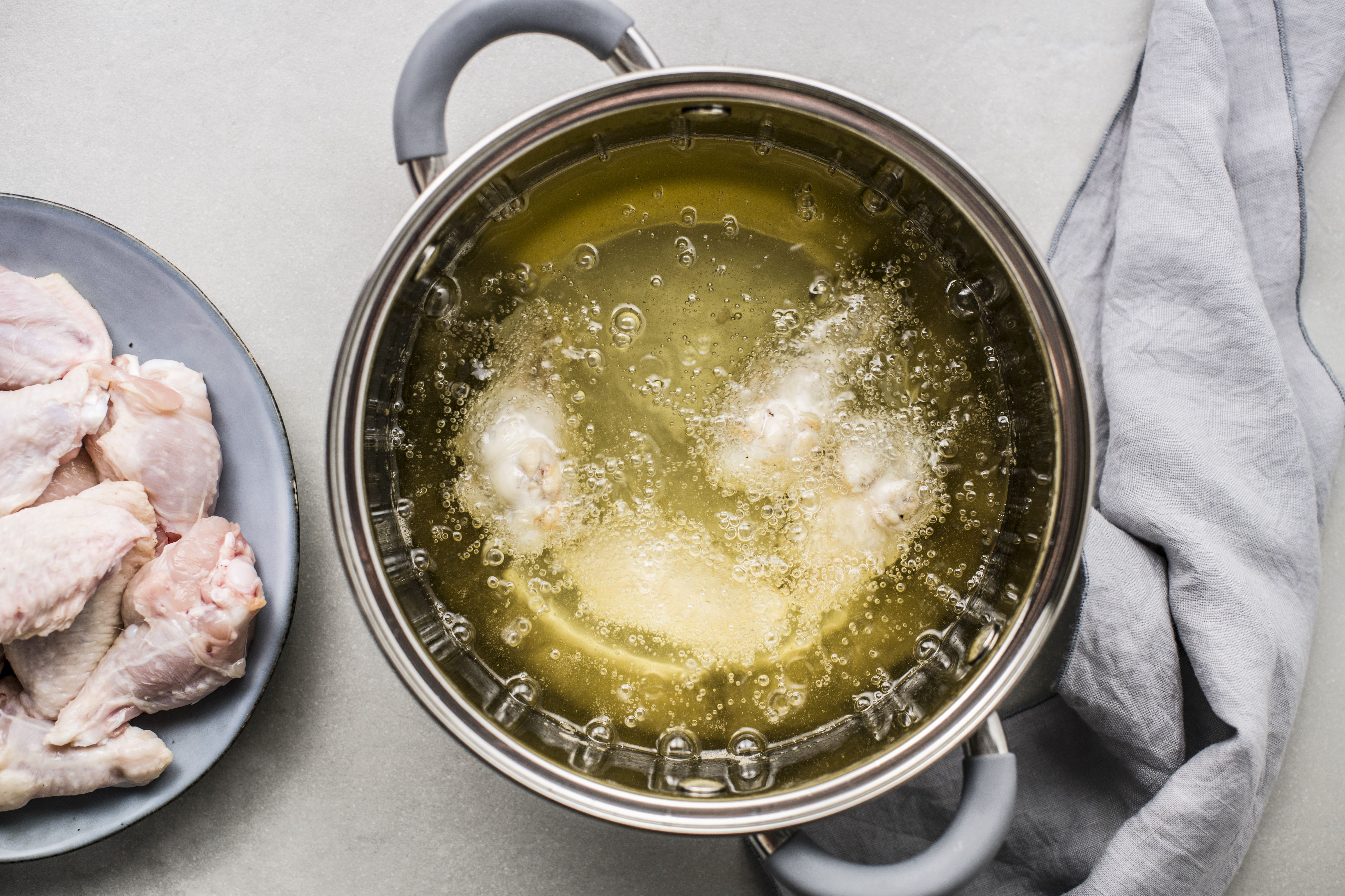 Place a few wings at a time in the hot oil to fry