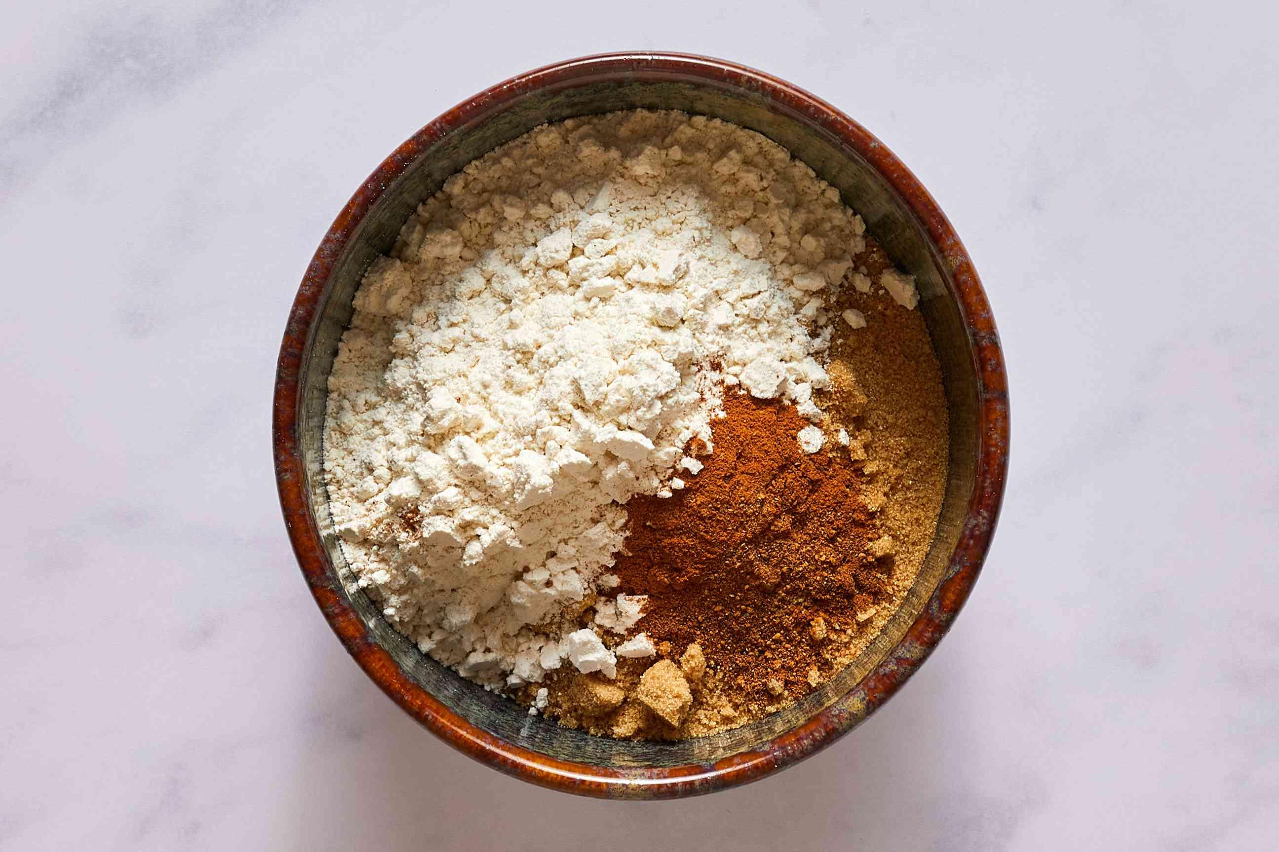 white sugar, brown sugar, flour, cinnamon, and nutmeg in a bowl