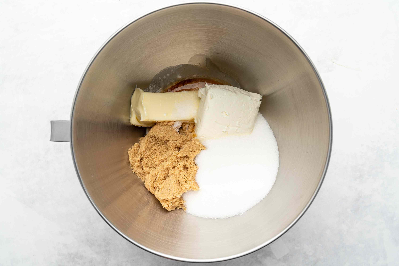 butter, cream cheese, brown sugar, white sugar, heavy cream, vanilla extract, and salt in a bowl