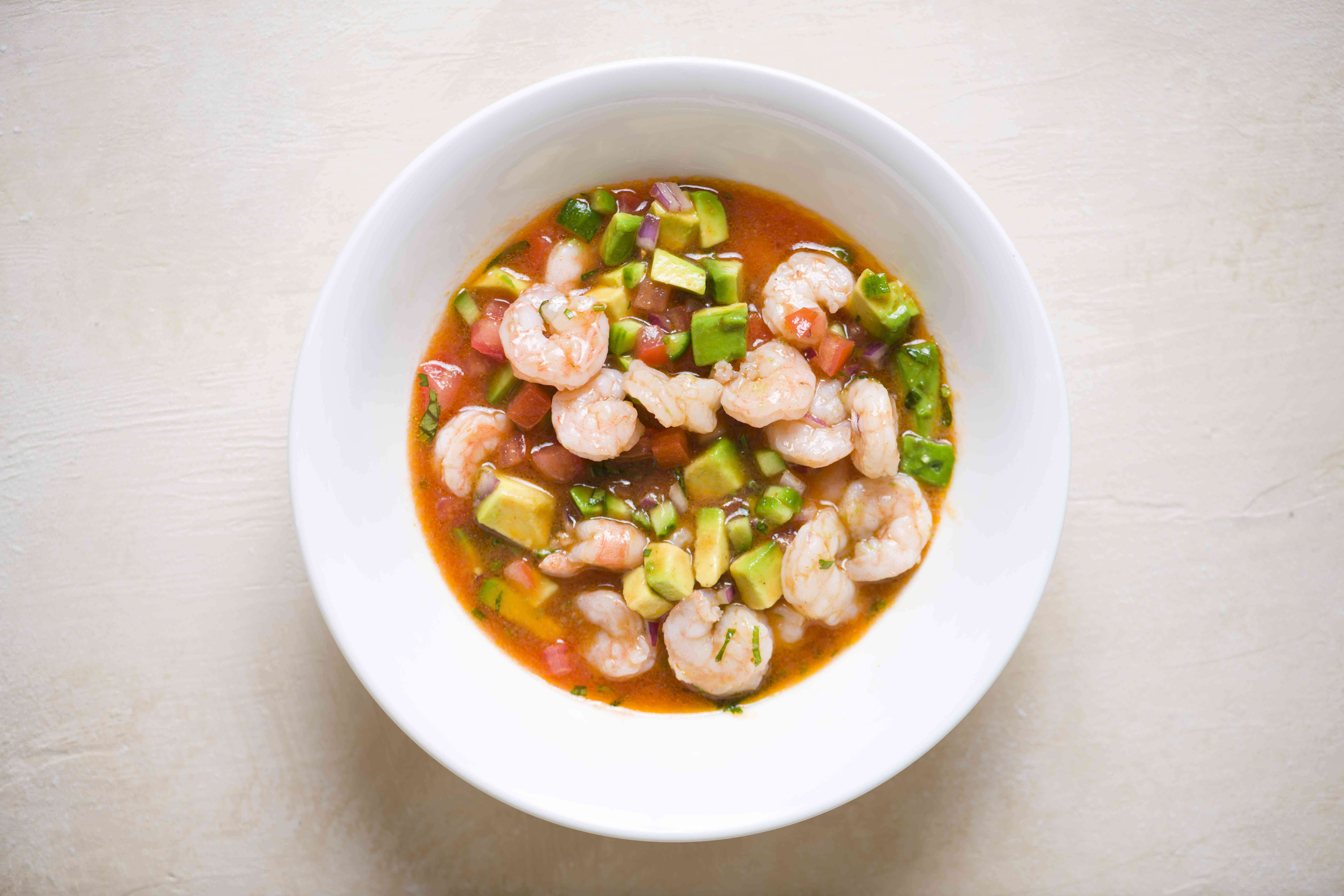 ceviche in a bowl with sauce
