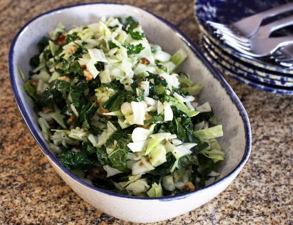 Kale and cabbage slaw with walnuts and Dijon mustard vinaigrette.