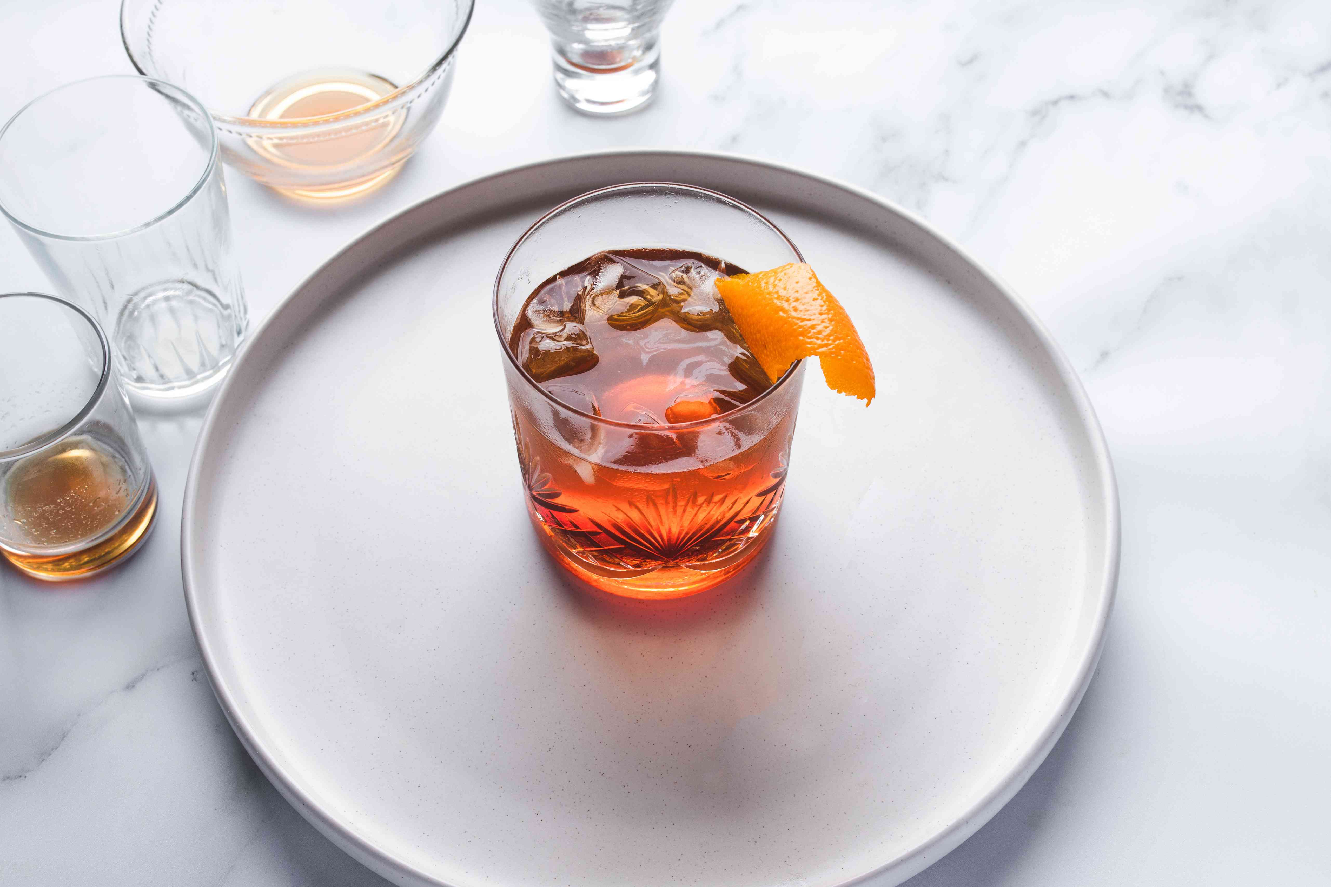 Garnish with an orange peel