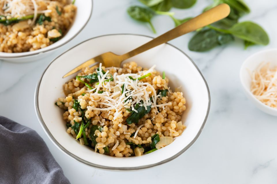 Israeli couscous risotto with spinach recipe