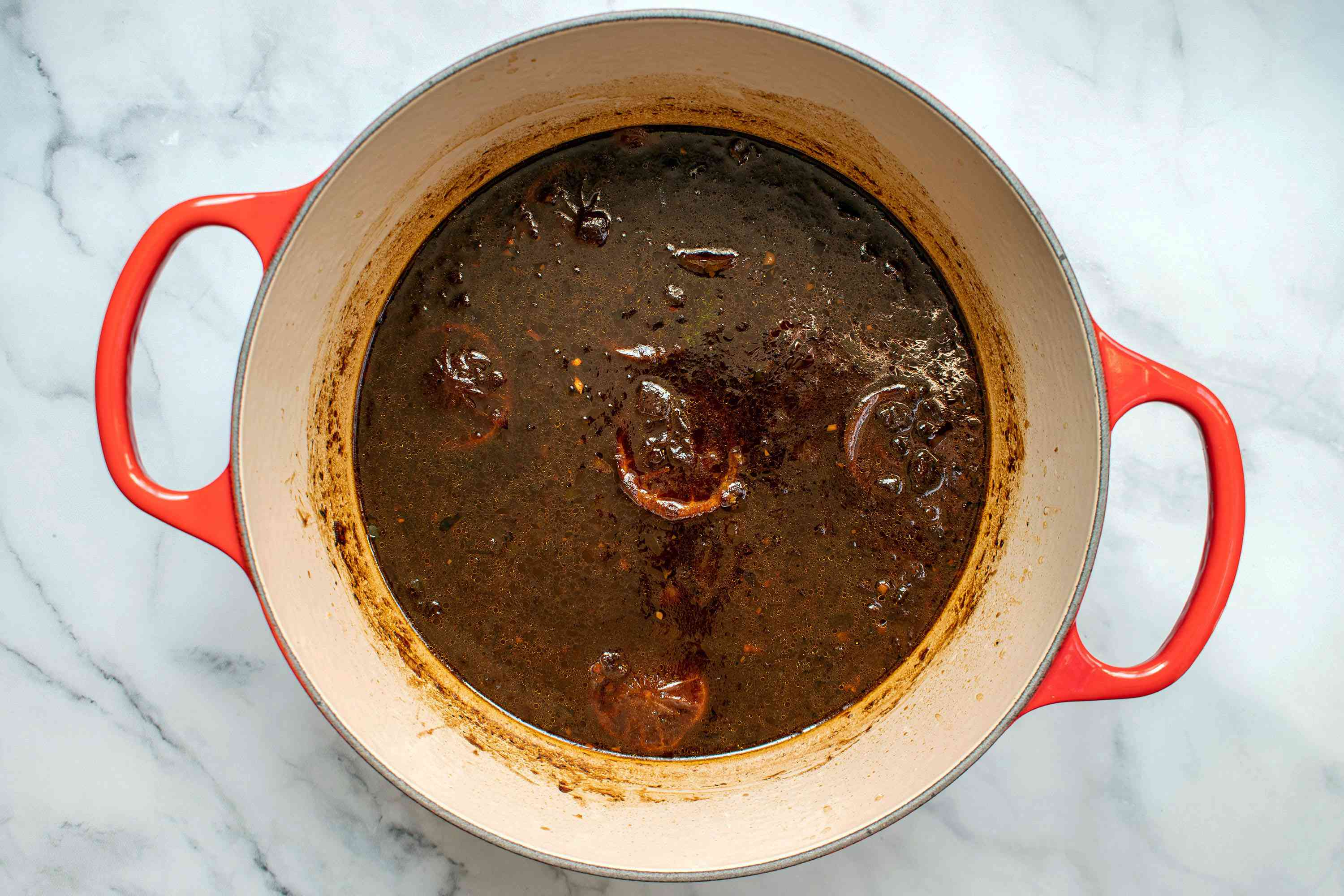 Homemade Worcestershire sauce ingredients cooking together in a large saucepan