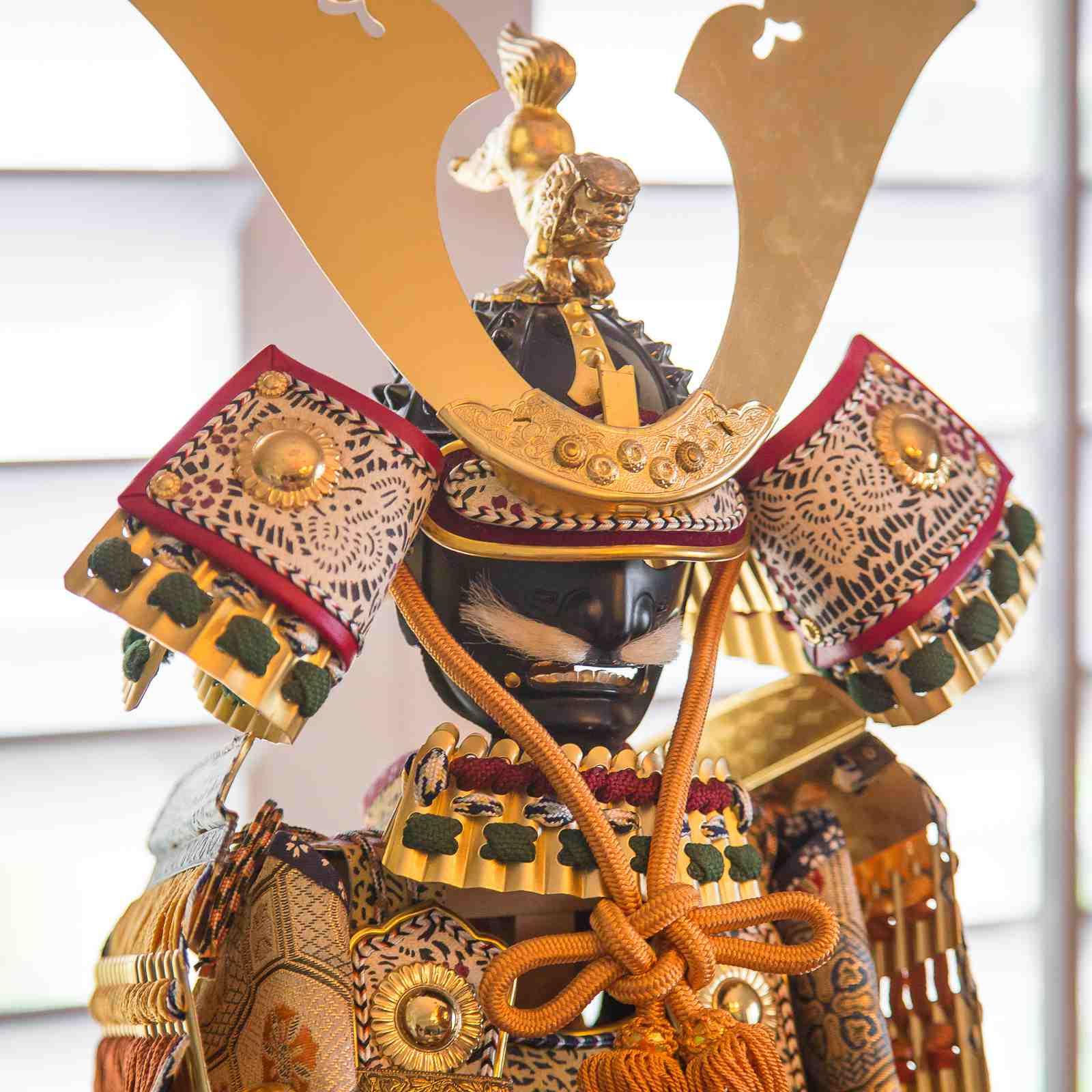 Gogatsu ningyo (Samurai soll) shown with Kabuto (Warrior Helmet)