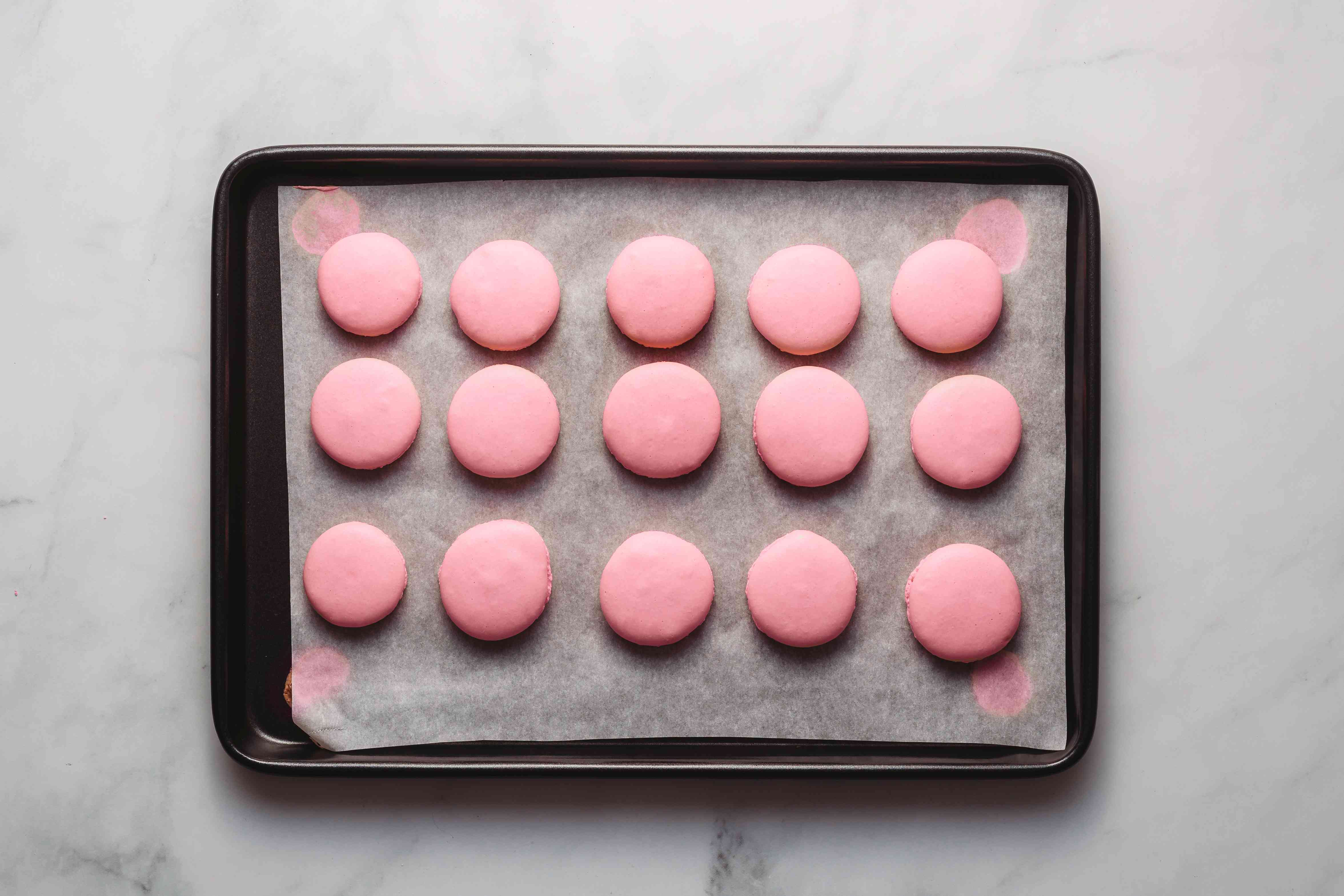 macarons on a baking sheet