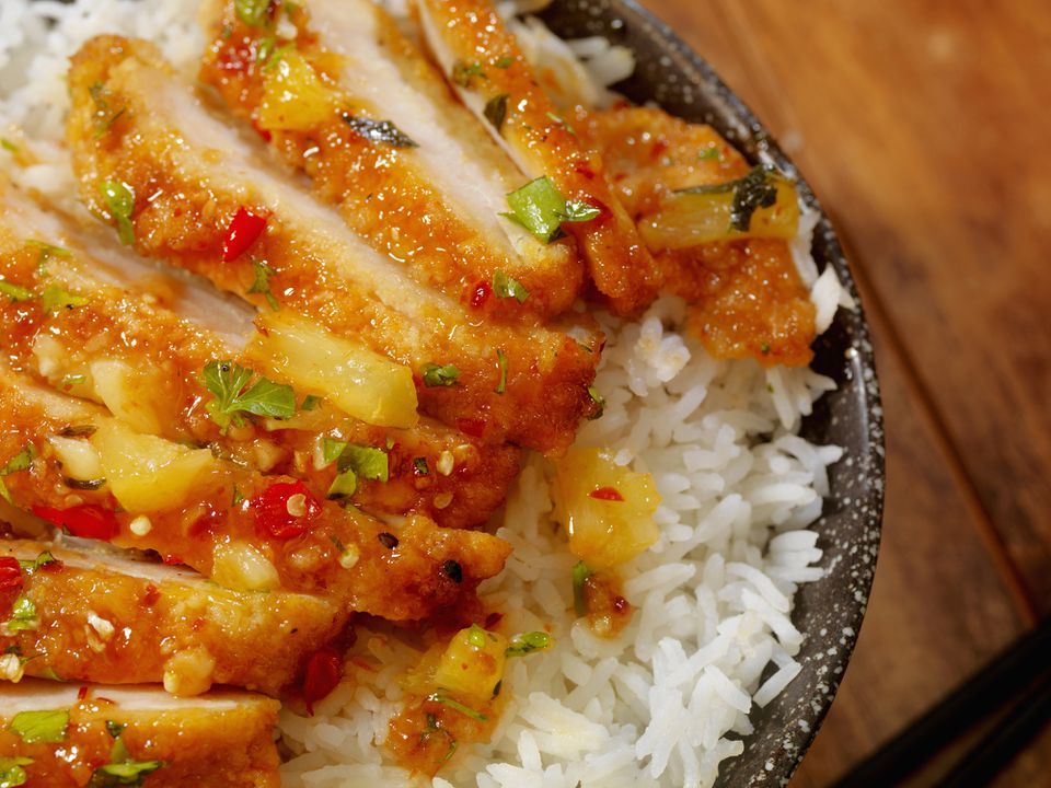 Sliced hoisin glazed chicken breasts and rice