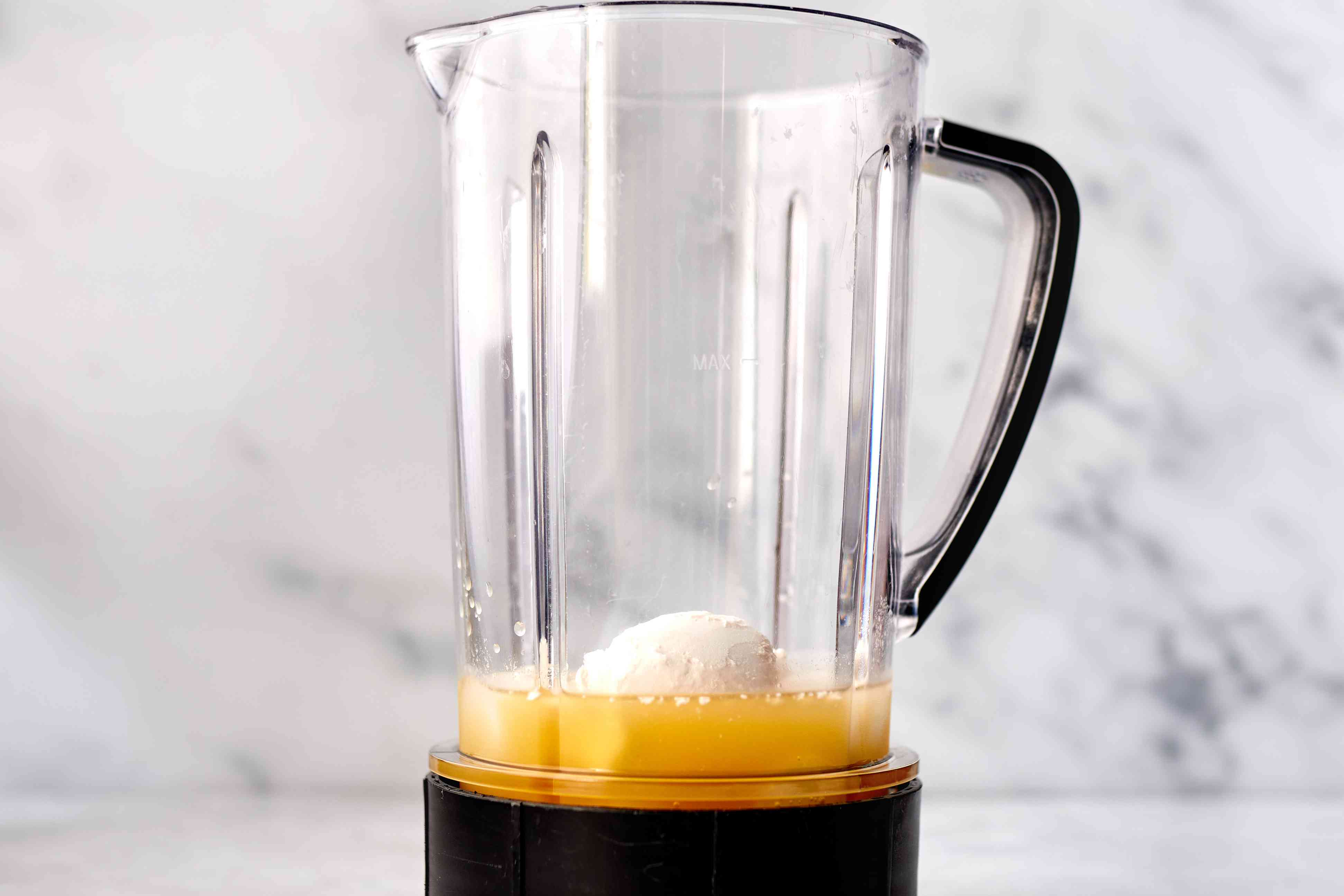 ice, pineapple juice, and cream of coconut in a blender